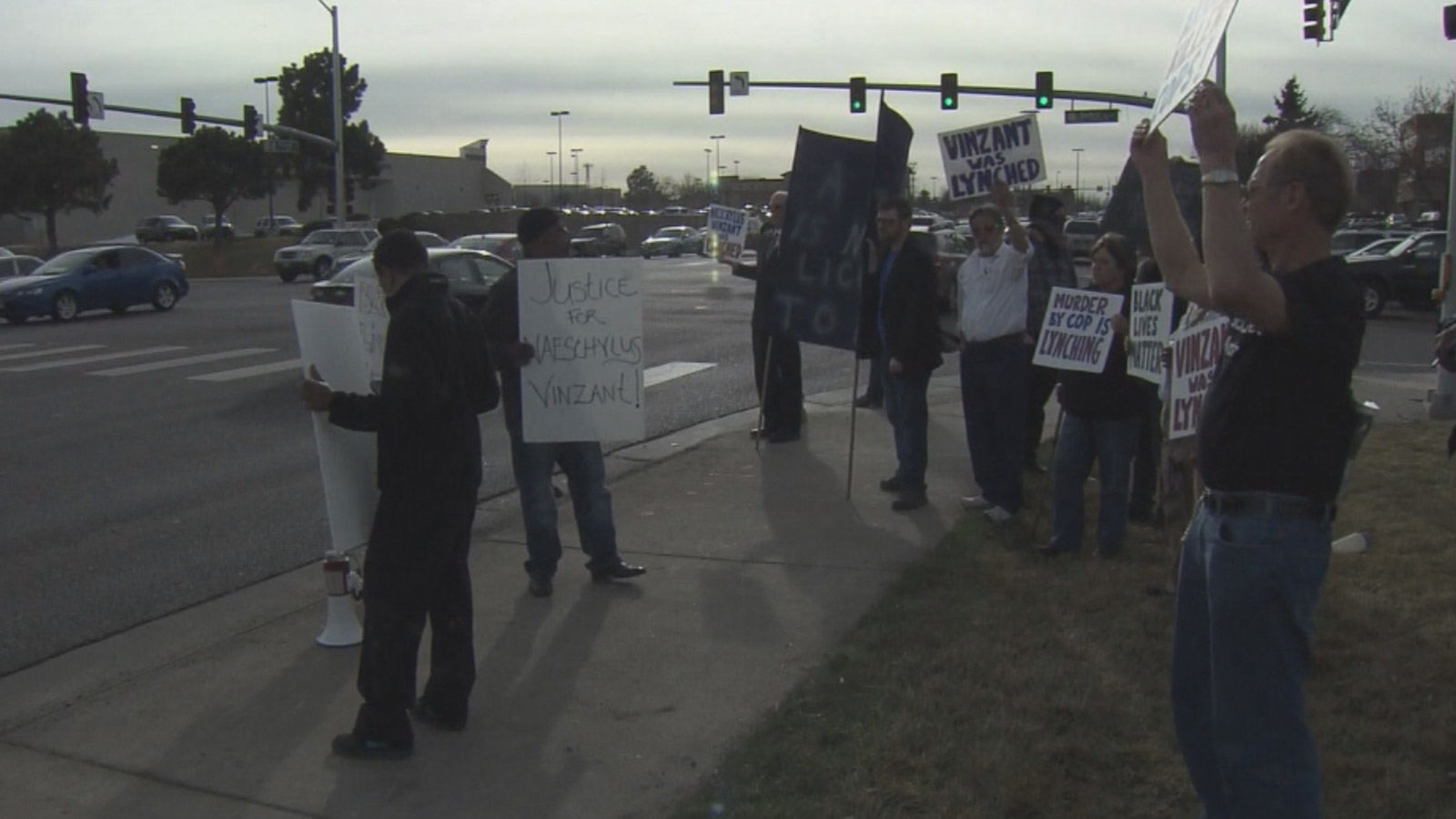 Protesters gathered near the Aurora Police Headquarters to protest the deadly shooting of  Naeschylus Vinzant (credit: CBS)