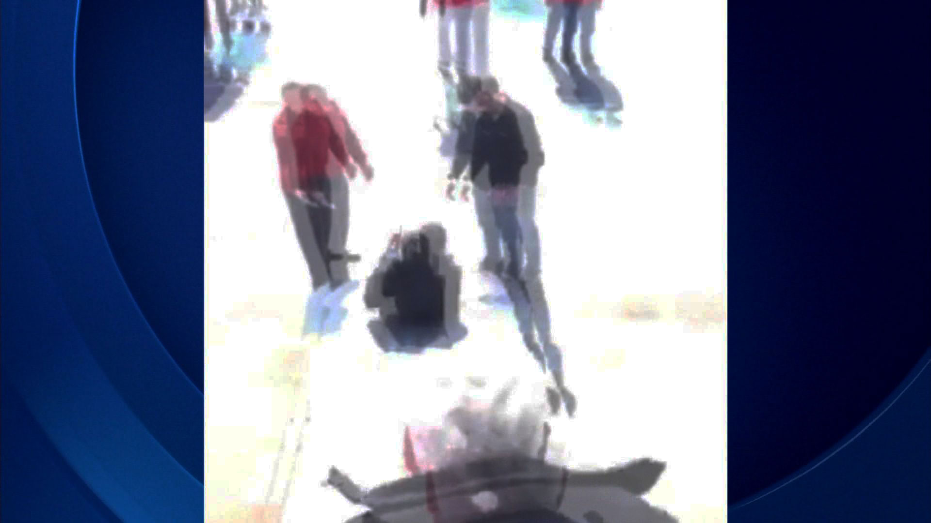 An image from cellphone video of passengers sliding down an emergency chute (credit: Derek Hart)