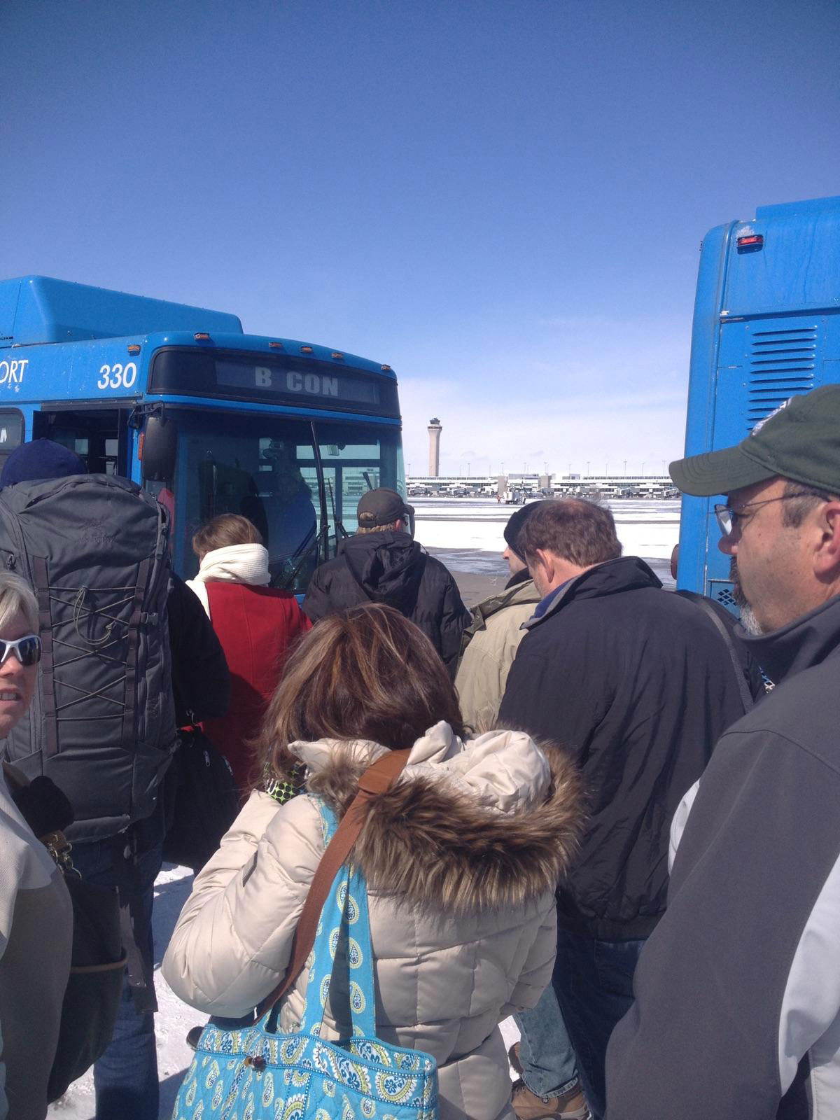 Passengers loading buses to the concourse (credit: Andy Aldridge)