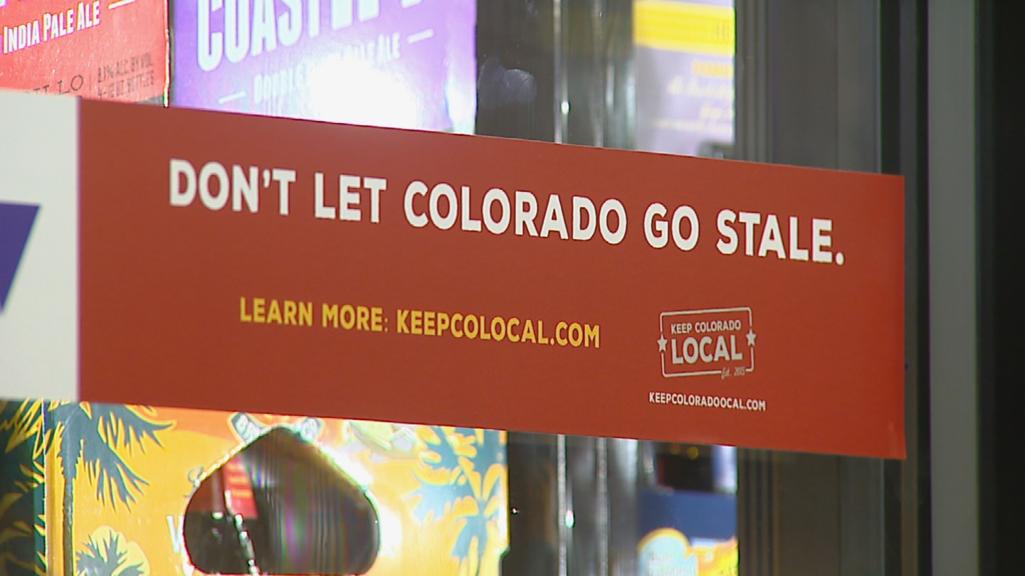 A sign in support of local liquor stores (credit: CBS)