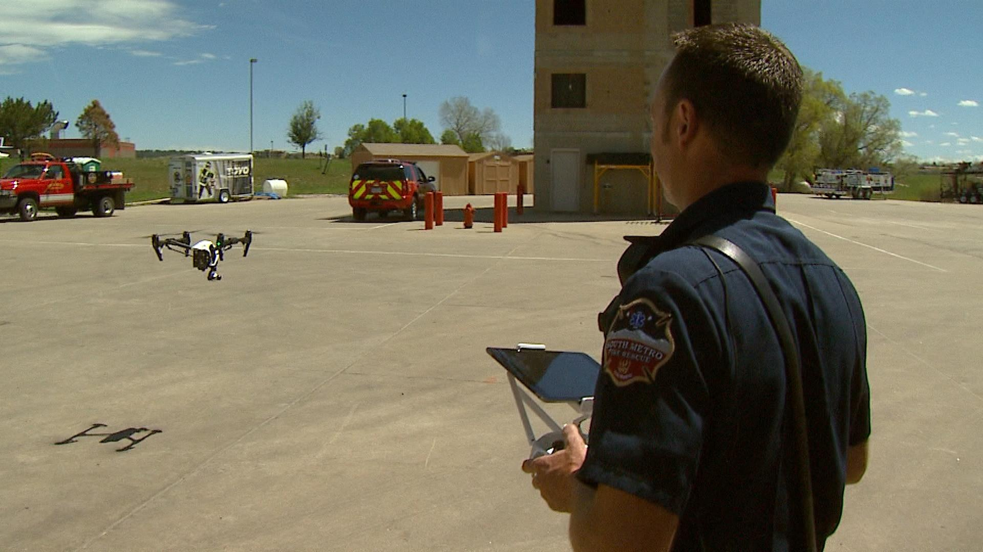 Cpt. Andy Powell with South Metro Fire Rescue Authority flies a drone (credit: CBS)