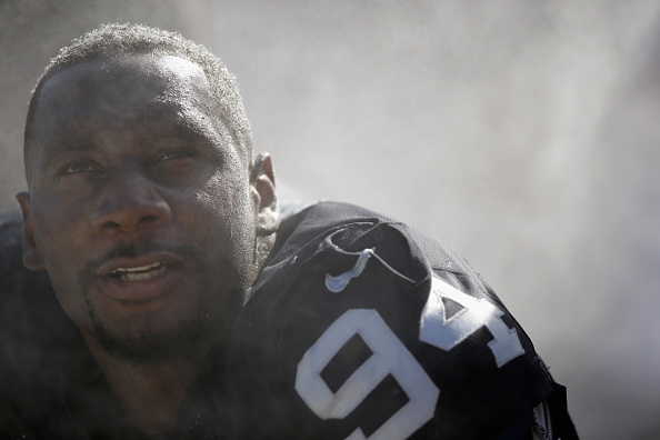 Antonio Smith #94 of the Oakland Raiders sits on the sidelines during their game against the San Diego Chargers at O.co Coliseum on October 12, 2014 in Oakland, California.  (Photo by Ezra Shaw/Getty Images)