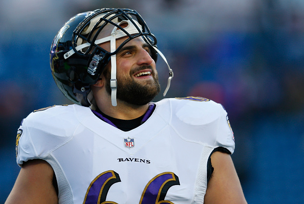 Gino Gradkowski #66 of the Baltimore Ravens looks on in warm ups before the 2014 AFC Divisional Playoffs game against the New England Patriots at Gillette Stadium on January 10, 2015 in Foxboro, Massachusetts. (Photo by Jim Rogash/Getty Images)