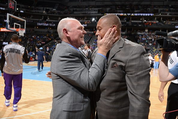 George Karl, head coach of the Sacramento Kings, exchanges a friendly greeting with Melvin Hunt, head coach of the Denver Nuggets, on April 12, 2015, at the Pepsi Center. (credit: Garrett W. Ellwood/NBAE via Getty Images)