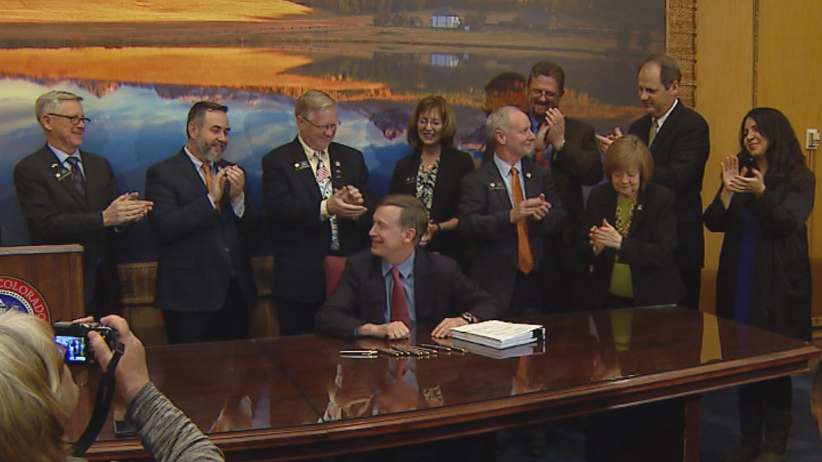 Gov. John Hickenlooper signs the state budget on Friday (credit: CBS)