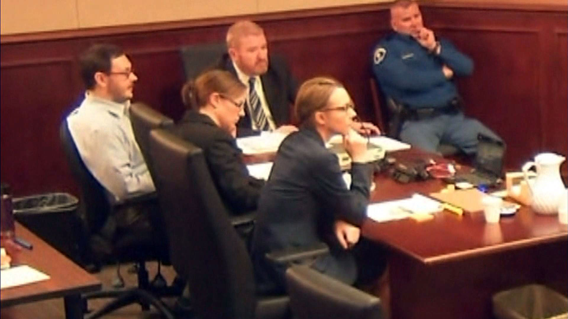 James Holmes with this defense team in court (credit: CBS)