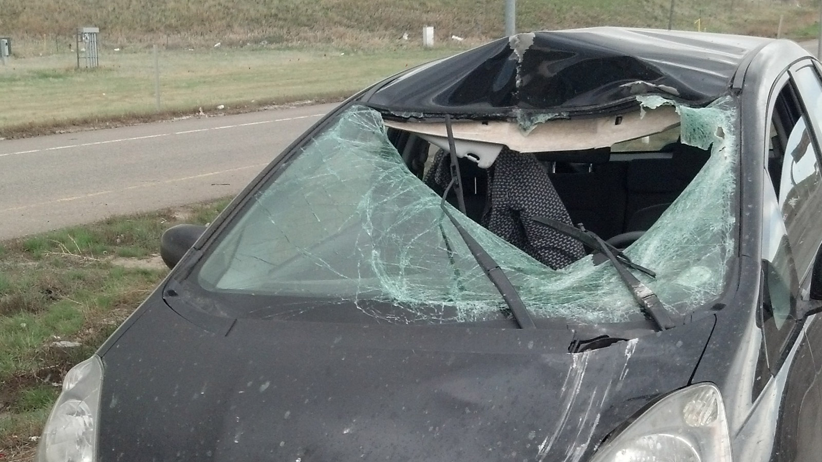 Martin Tsibrov's car after a portion of the concrete barrier smashed through the windshield (credit: Martin Tsibrov)