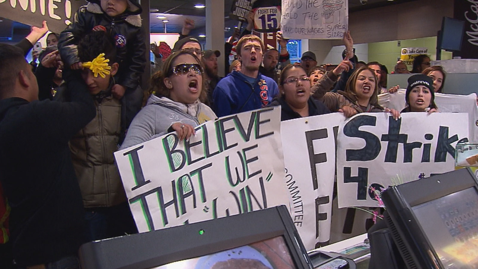 """""""Fight for $15"""" protesters rally inside a McDonald's restaurant at Colfax Avenue and Osage Street in Denver (credit: CBS)"""