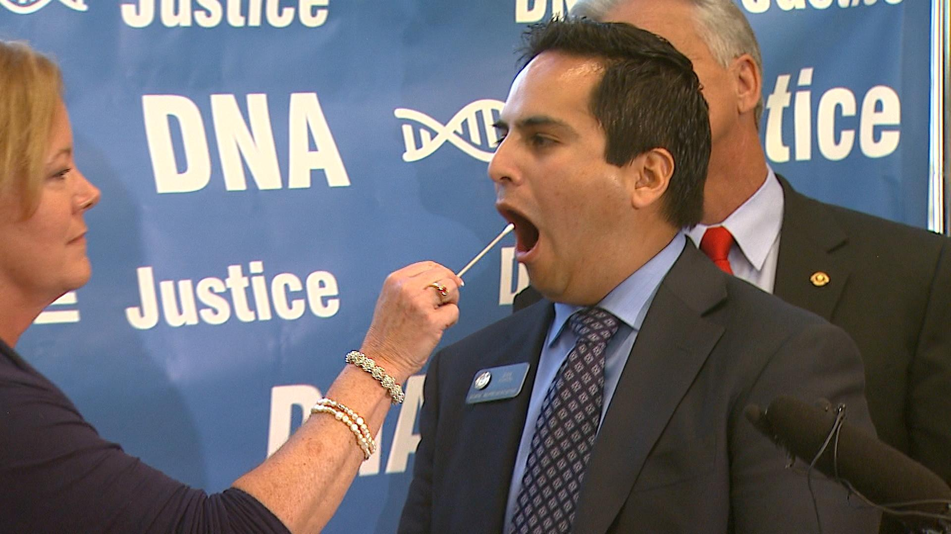 Rep. Polly Lawrence swabs the inside of Rep. Dan Pabon's cheek (credit: CBS)