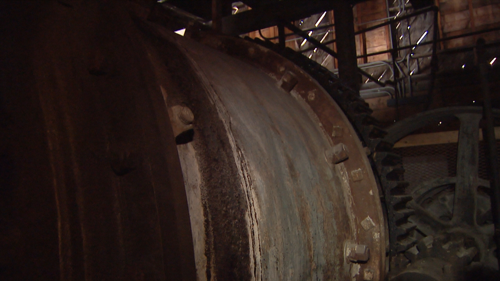 One of the ball mills inside the processing mill. This is essentially a large rock tumbler with heavy metal balls that crush the rock into a fine powder (credit: CBS)