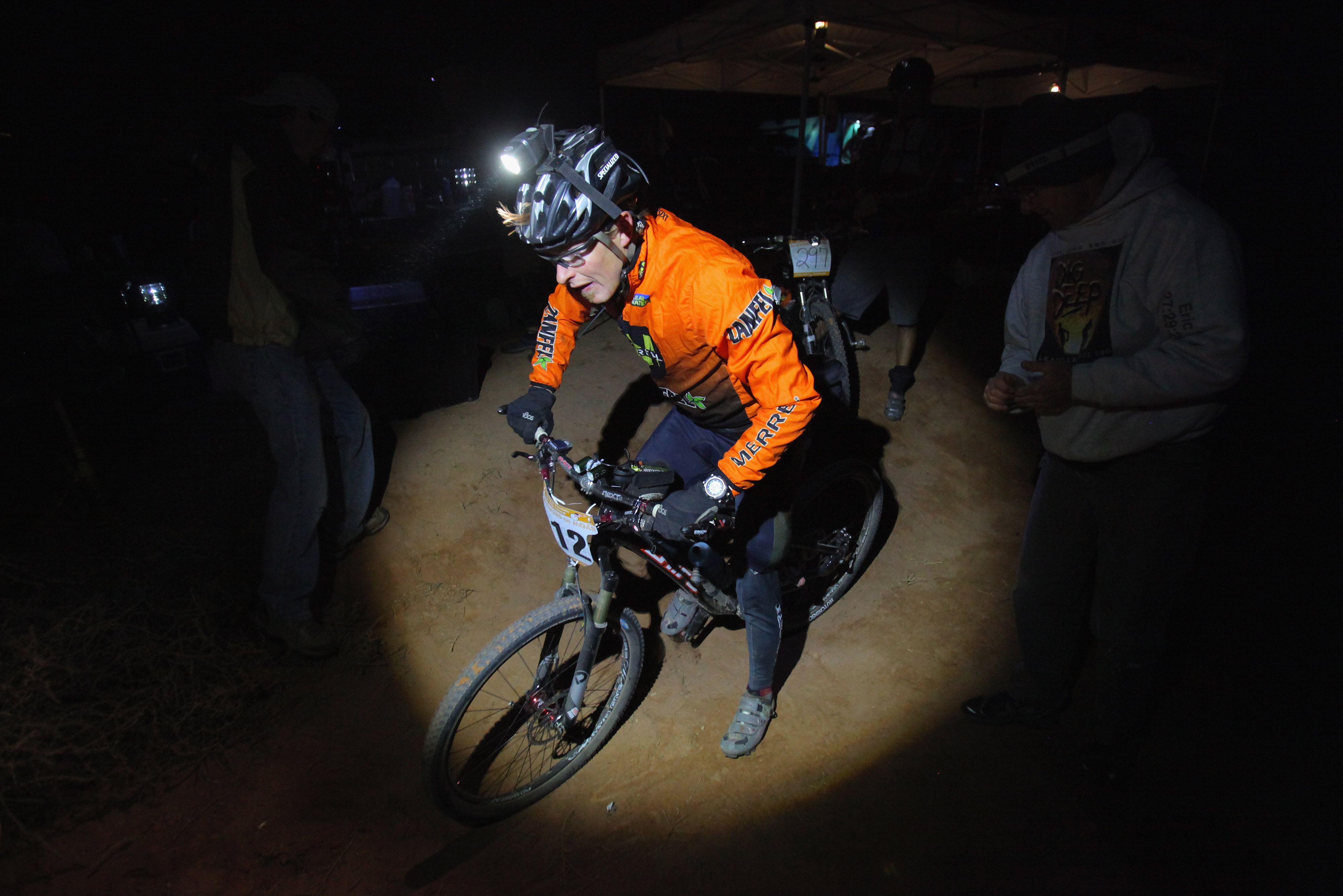 Solo men's rider Travis Macy of Evergreen, Colorado leaves his support area in the midnight hour enroute to finishing seventh place in the 24 Hours of Moab Mountain Bike Race on Oct. 9, 2010, in Moab, Utah. More than 1000 mountain bikers are estimated to complete more than 7000 laps on the 14.9 mile course.  (Photo by Doug Pensinger/Getty Images)