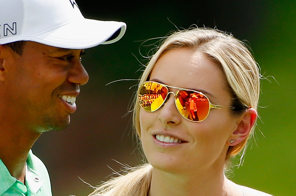 Tiger Woods of the United States chats with his girlfriend Lindsey Vonn during the Par 3 Contest prior to the start of the 2015 Masters Tournament at Augusta National Golf Club on April 8, 2015 in Augusta, Georgia.  (Photo by Ezra Shaw/Getty Images)