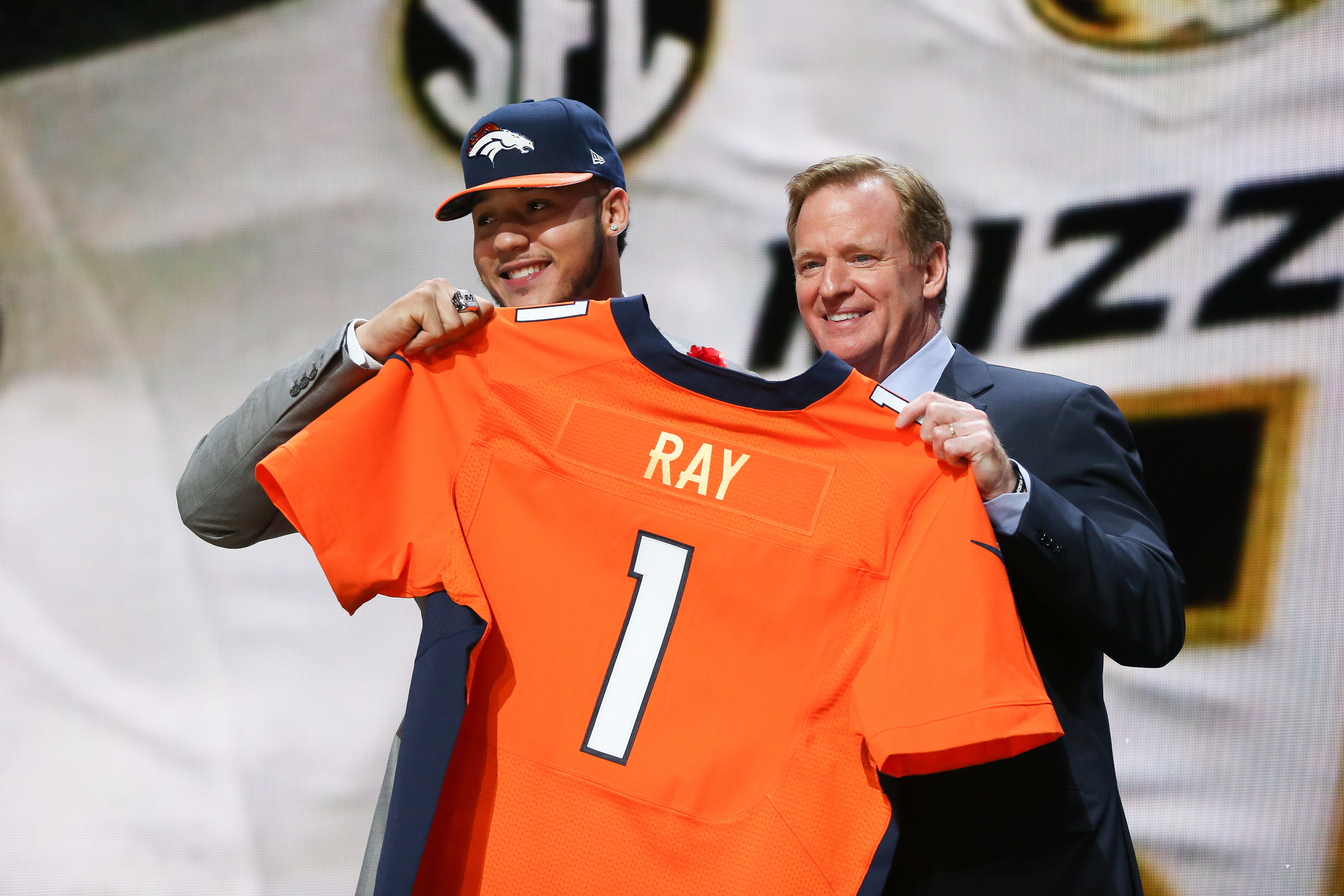 Shane Ray of the Missouri Tigers holds up a jersey with NFL Commissioner Roger Goodell after being picked #23 overall by the Denver Broncos during the first round of the 2015 NFL Draft at the Auditorium Theatre of Roosevelt University on April 30, 2015 in Chicago, Illinois.  (Photo by Jonathan Daniel/Getty Images)