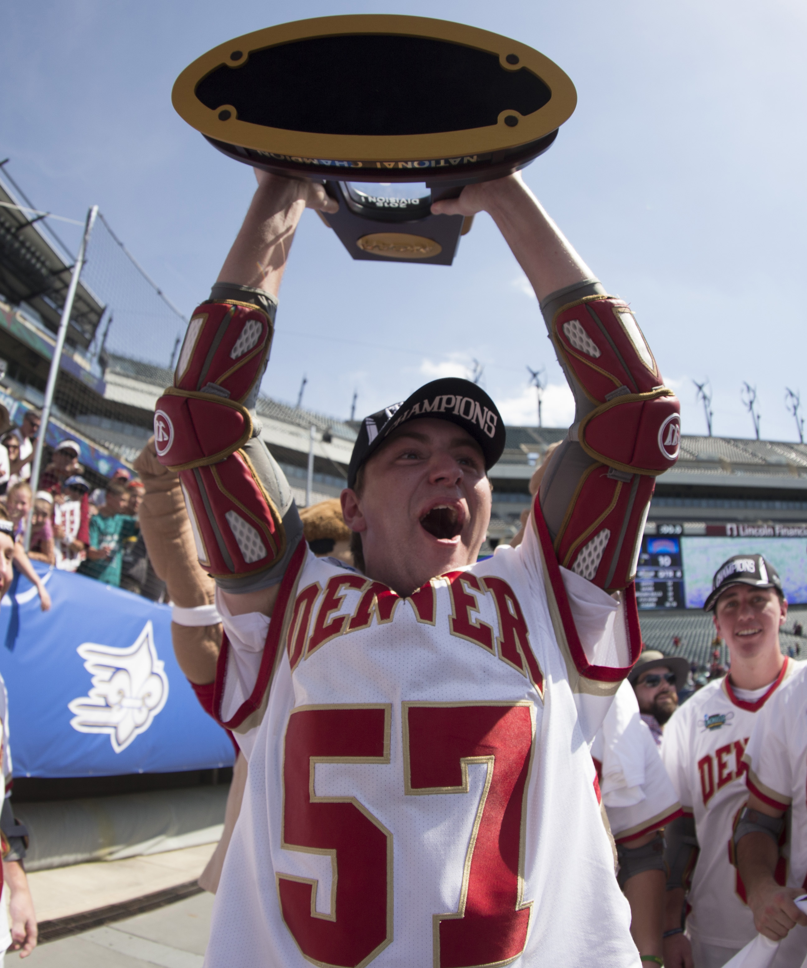 Colin Woolford #57 of the Denver Pioneers holds up the trophy after the game against the Maryland Terrapins on May 25, 2015 in the NCAA Division I Men's Lacrosse Championship at Lincoln Financial Field in Philadelphia, Pennsylvania. The Pioneers defeated the Terrapins 10-5. (Photo by Mitchell Leff/Getty Images)