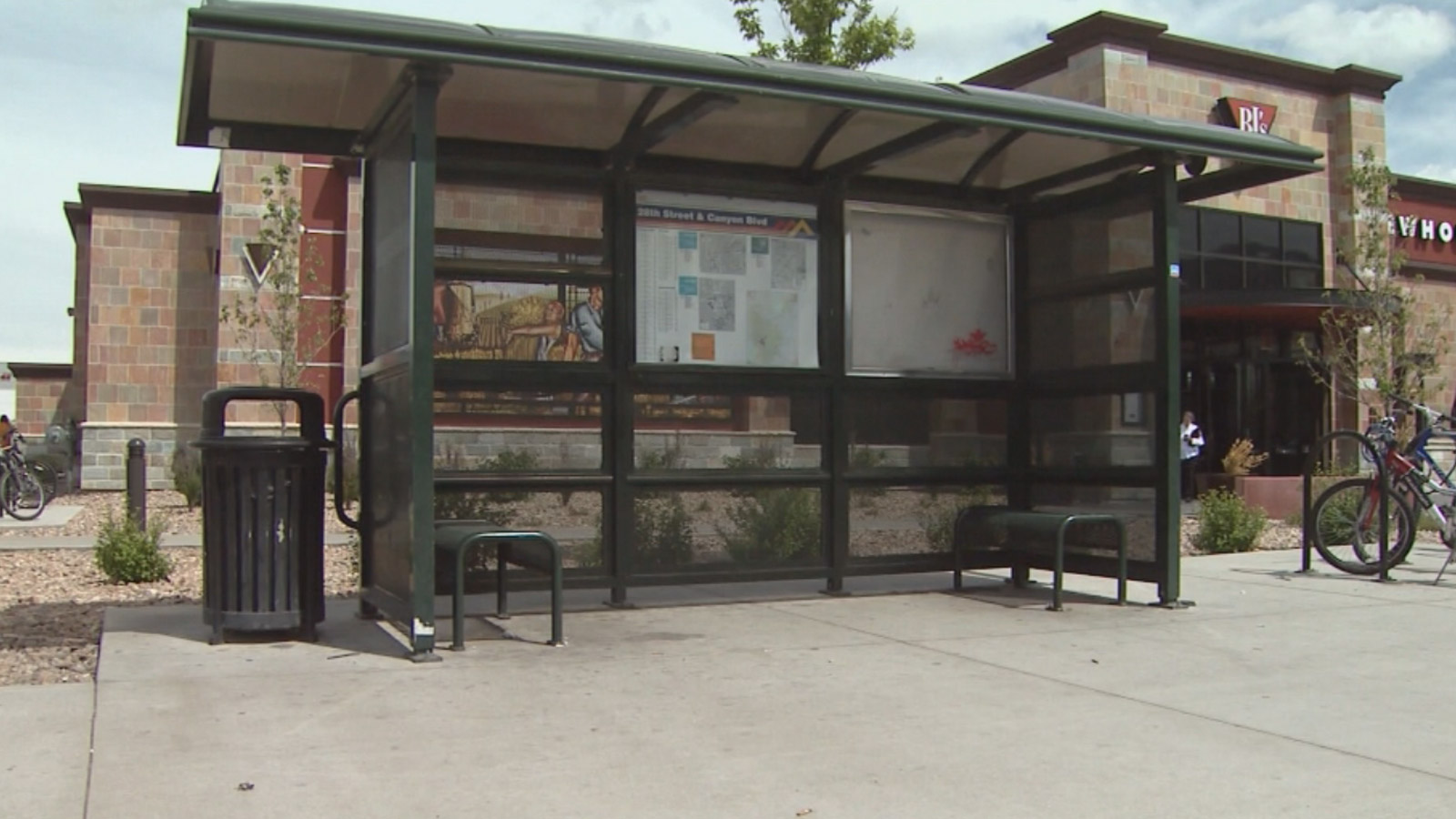 The bus stop in Boulder where a transgender man was attacked (credit: CBS)