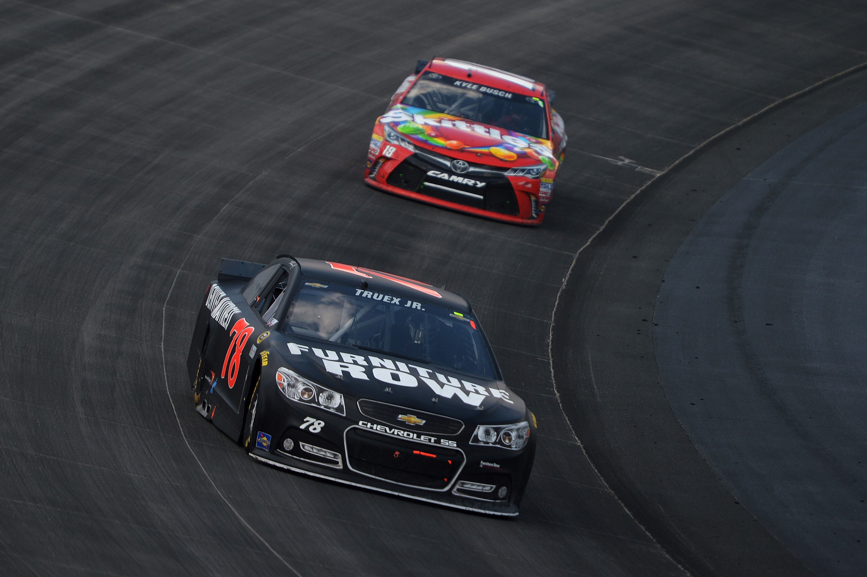 Martin Truex Jr., driver of the #78 Furniture Row/Visser Precision Chevrolet, leads Kyle Busch, driver of the #18 Skittles Toyota, during the NASCAR Sprint Cup Series FedEx 400 Benefiting Autism Speaks at Dover International Speedway on May 31, 2015 in Dover, Delaware. (Photo by Drew Hallowell/Getty Images)