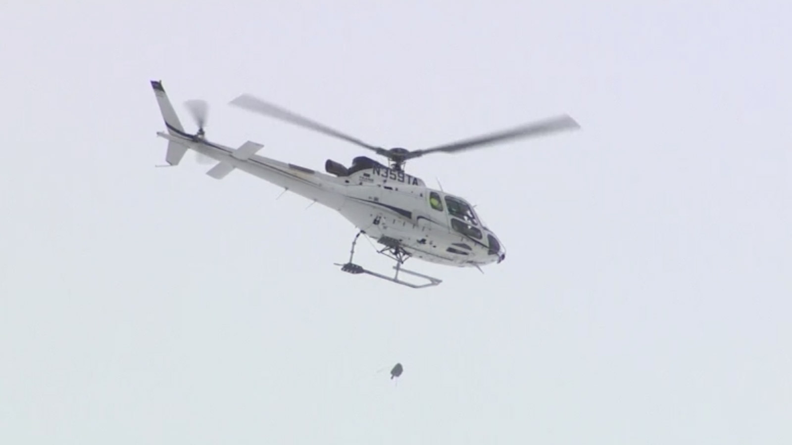 A helicopter drops a bomb on a snow slab on Independence Pass (credit: CBS)