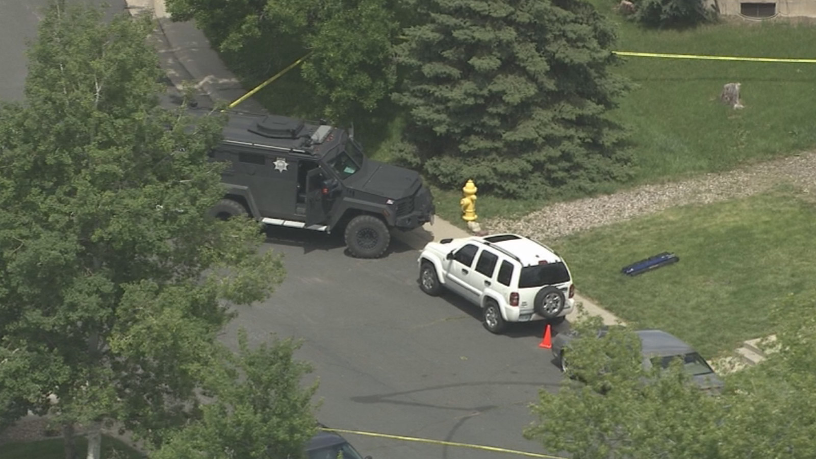 Copter4 flew over the home where the Northglenn Police officer was shot on Thursday (credit: CBS)