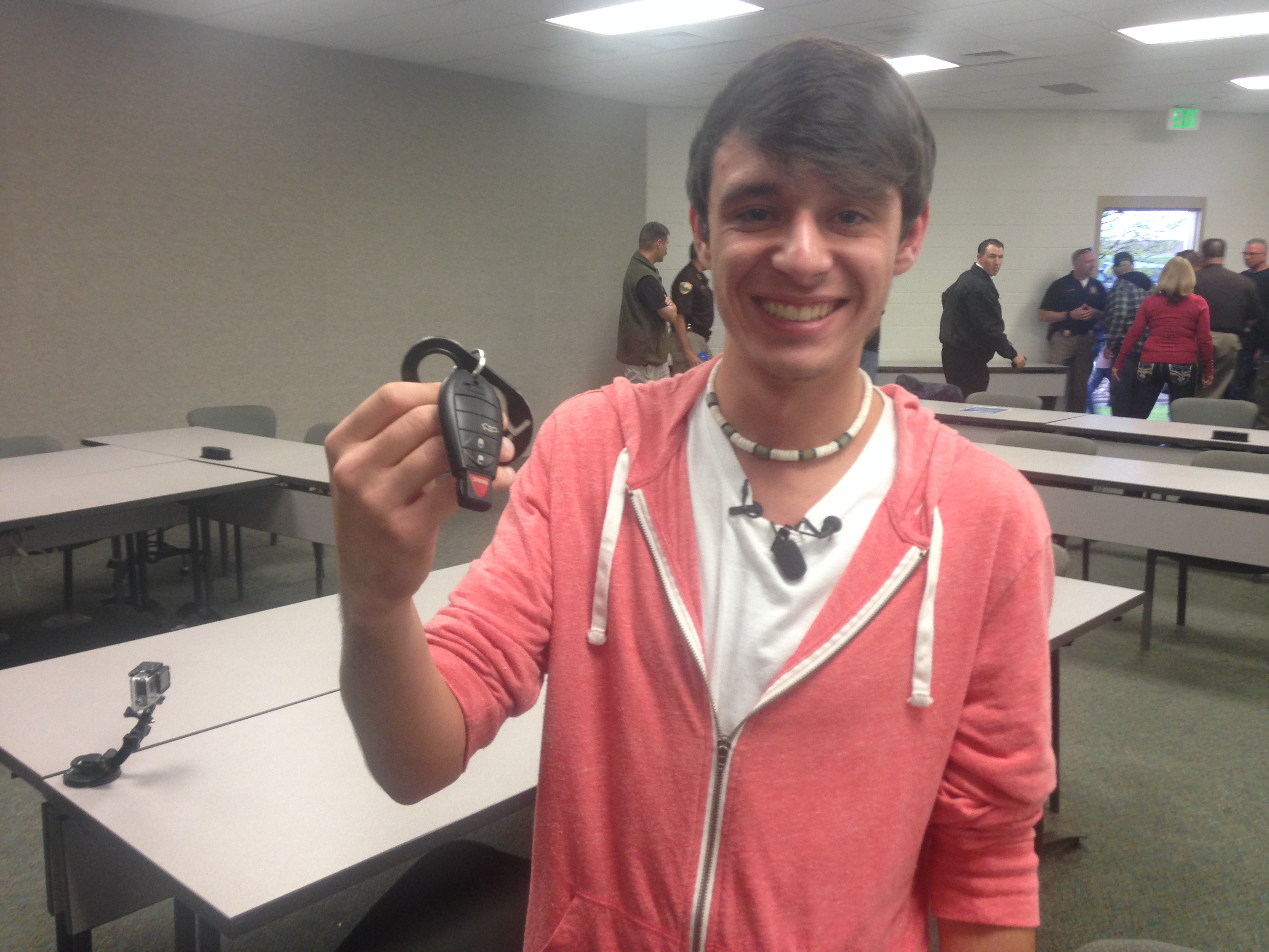 Tanner Brownlee with the keys to his father's patrol car (credit: Kelly Werthmann)