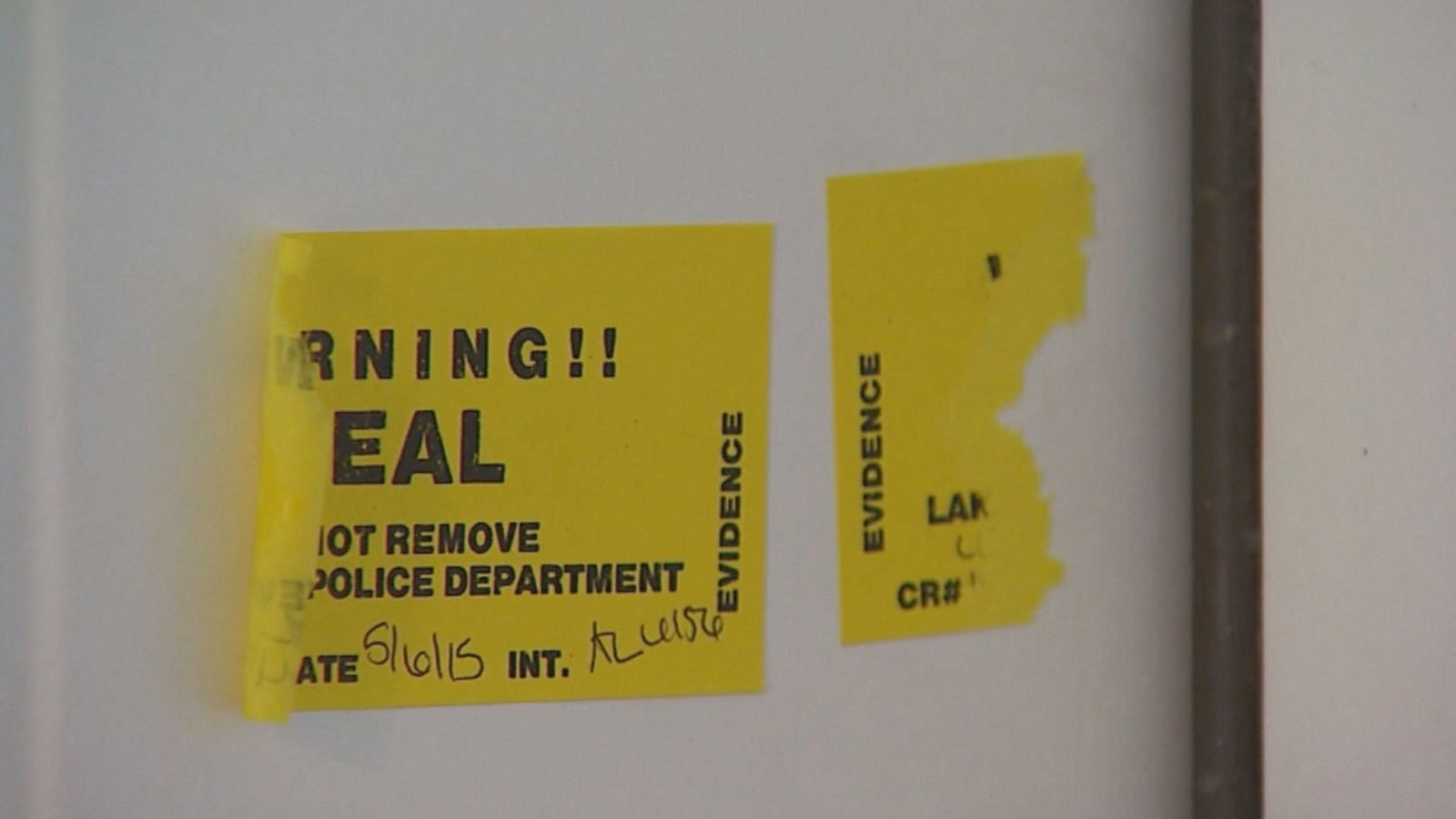 The evidence seal on the apartment where the 10-year-old boy was found unresponsive (credit: CBS)