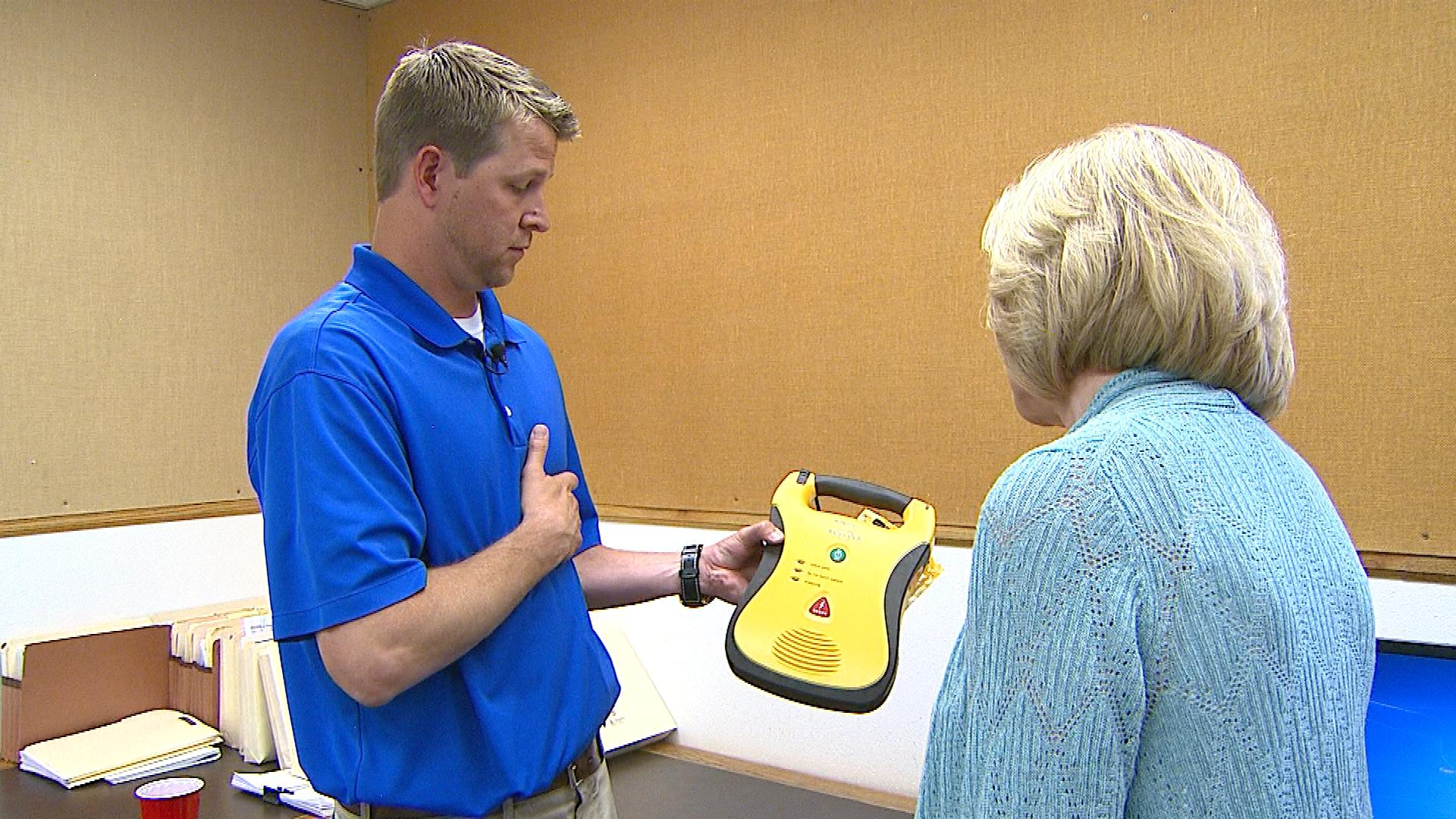 Cal Kelley show CBS4's Kathy Walsh their AED (credit: CBS)