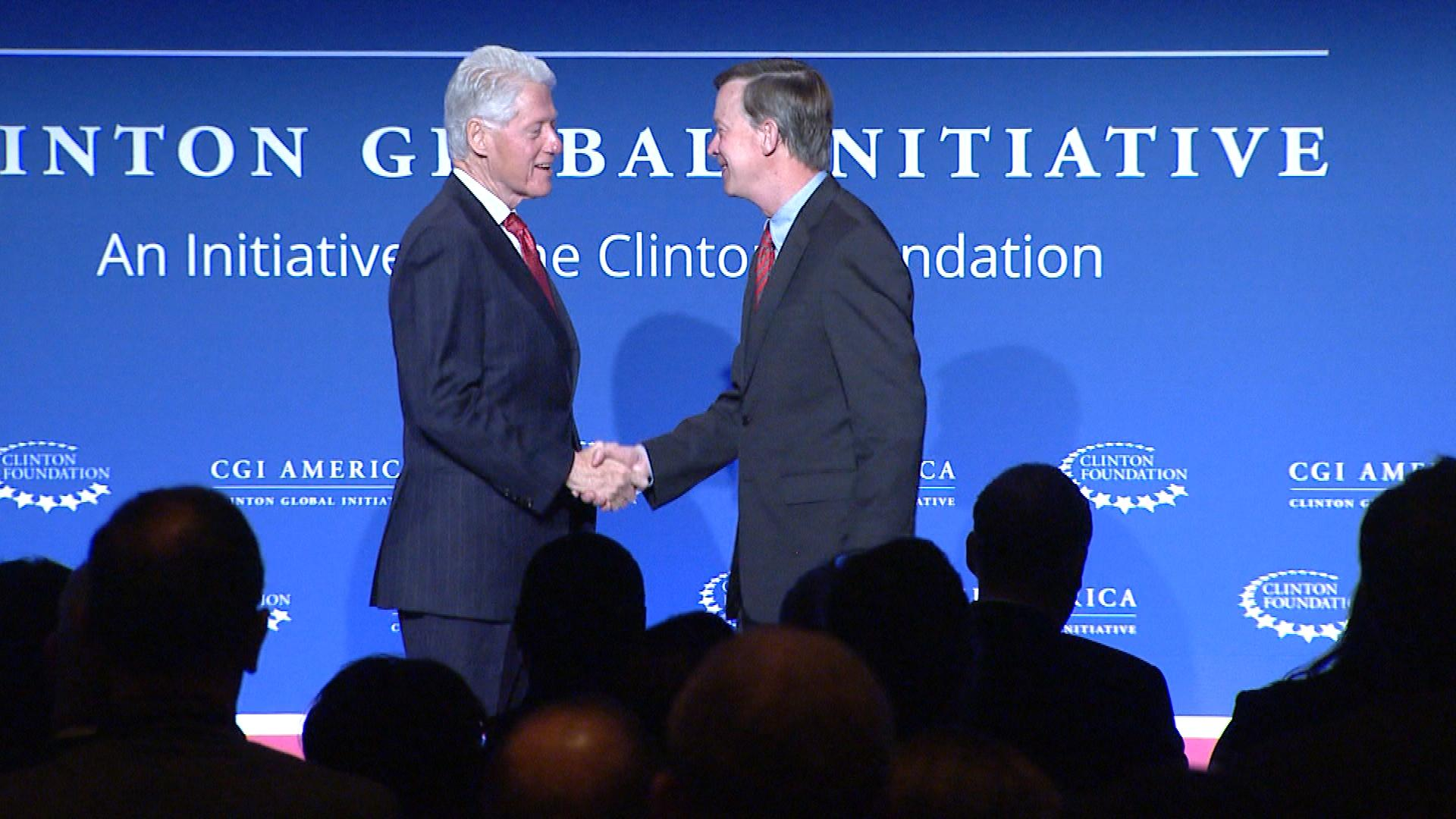 Bill Clinton and Gov. John Hickenlooper in Denver on Tuesday (credit: CBS)