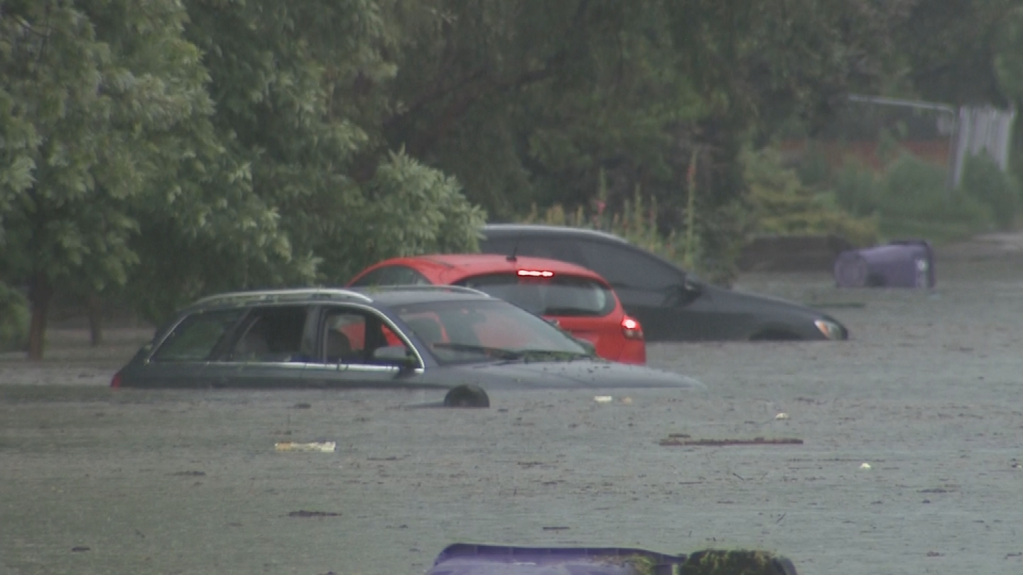 Flash flooding hits Denver's Park Hill neighborhood during a strong afternoon storm. (credit: CBS)