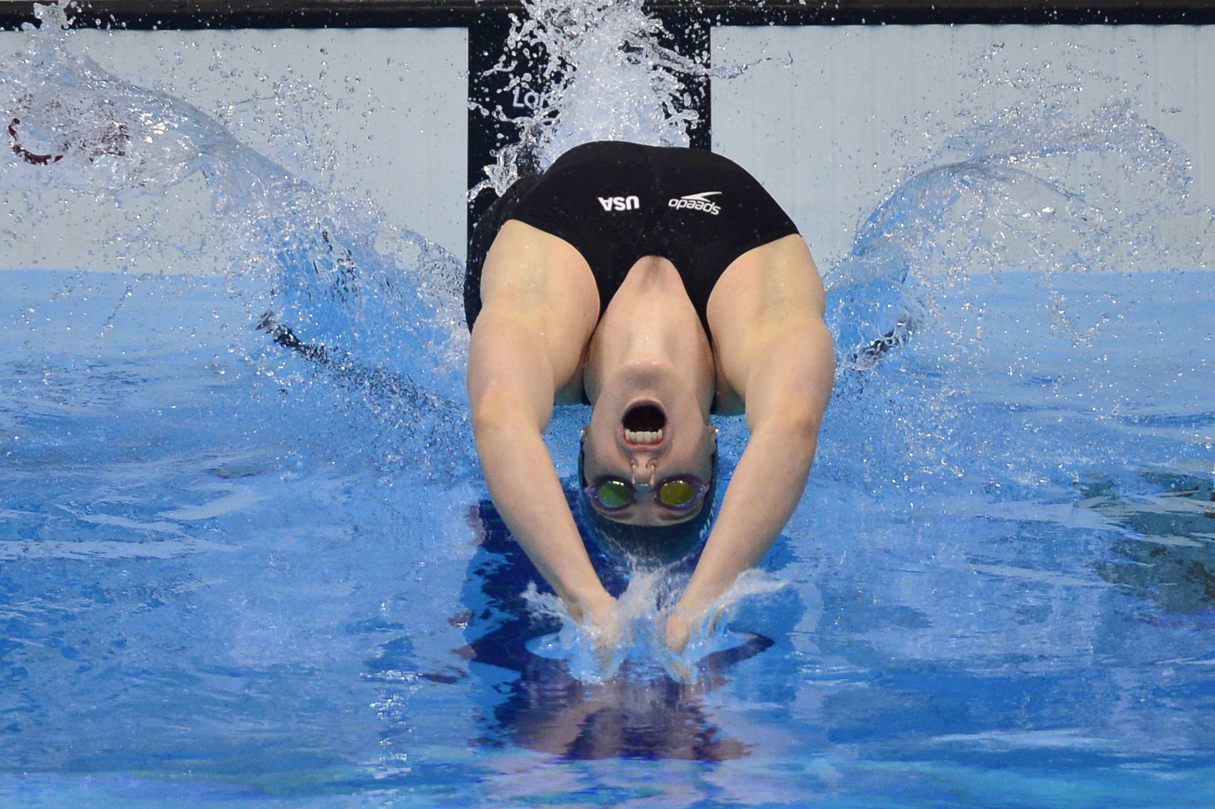 US swimmer Missy Franklin dives in at the start of the women's 100m backstroke final swimming event at the London 2012 Olympic Games on July 30, 2012 in London. (credit: FABRICE COFFRINI/AFP/GettyImages)
