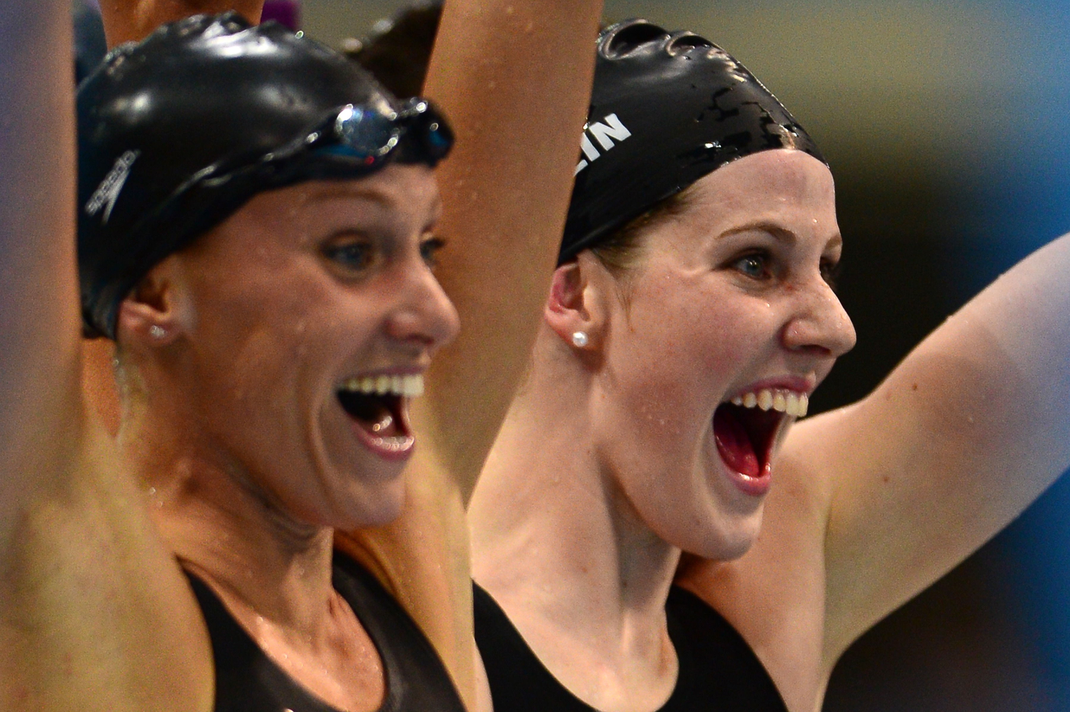 US swimmer Missy Franklin (R) and Dana Vollmer react after they competed in the women's 4x100m medley relay final during the swimming event at the London 2012 Olympic Games on August 4, 2012 in London. They won gold. (credit: MARTIN BUREAU/AFP/GettyImages)