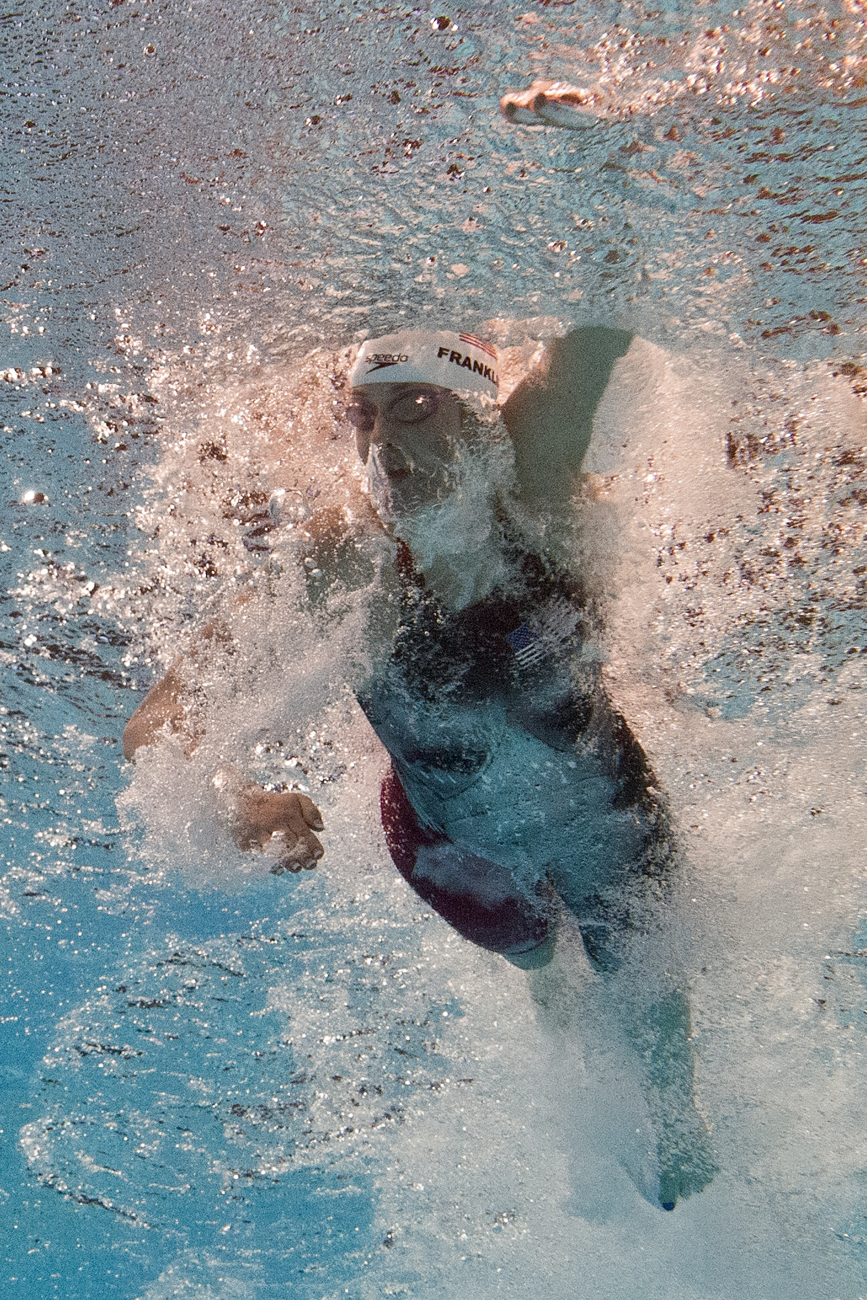 In a picture taken with an underwater camera US swimmer Missy Franklin competes in the heats of the women's 100-metre freestyle swimming event in the FINA World Championships at Palau Sant Jordi in Barcelona on August 1, 2013.  (Photo credit: FRANCOIS XAVIER MARIT/AFP/Getty Images)