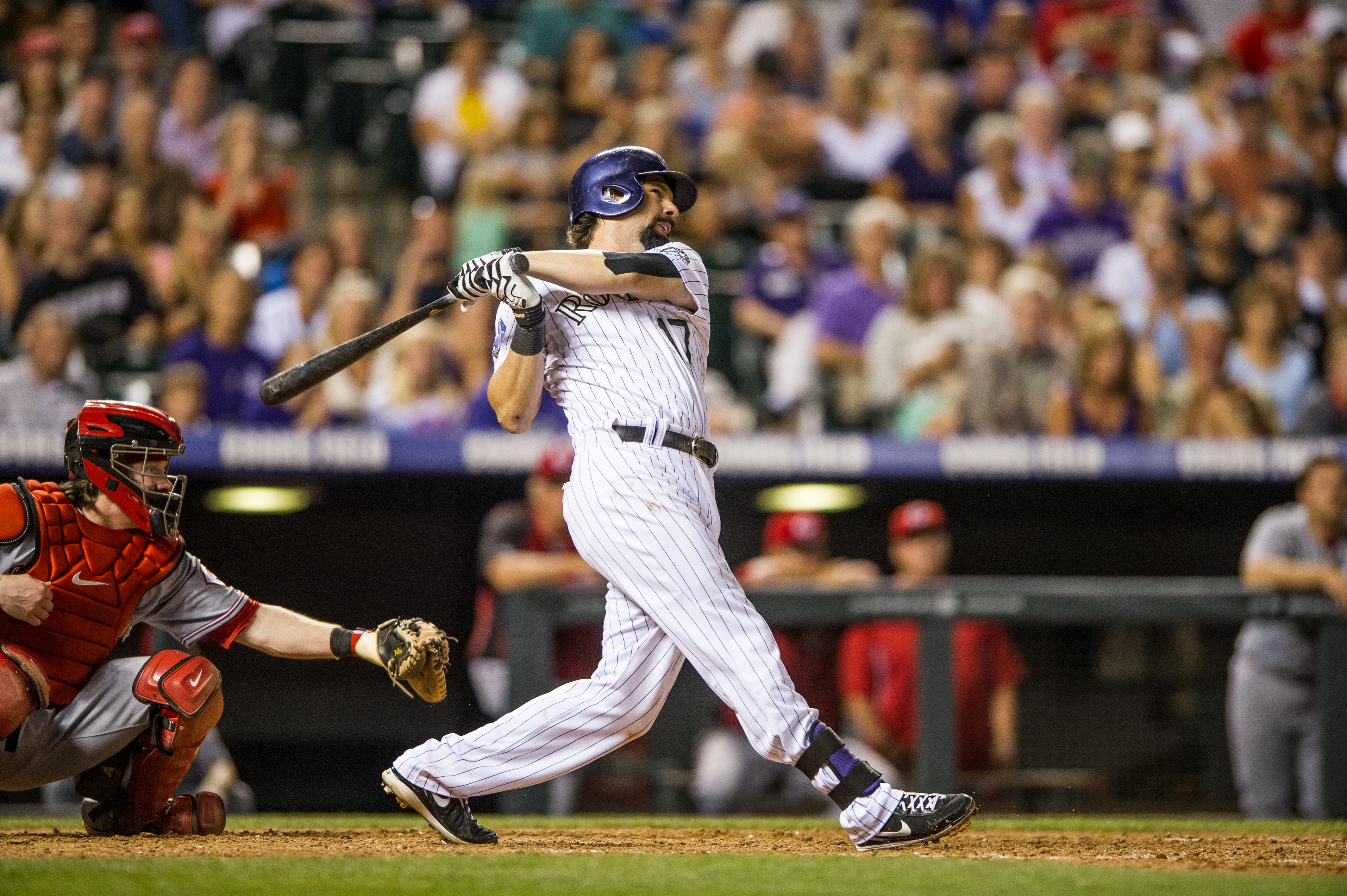 Todd Helton #17 of the Colorado Rockies hits his second three-run home run of the game for his 2,499th career hit in the seventh inning of a game against the Cincinnati Reds at Coors Field on August 30, 2013 in Denver, Colorado. The Rockies beat the Reds 9-6. Helton hold the Rockies record for the most home runs (Photo by Dustin Bradford/Getty Images)