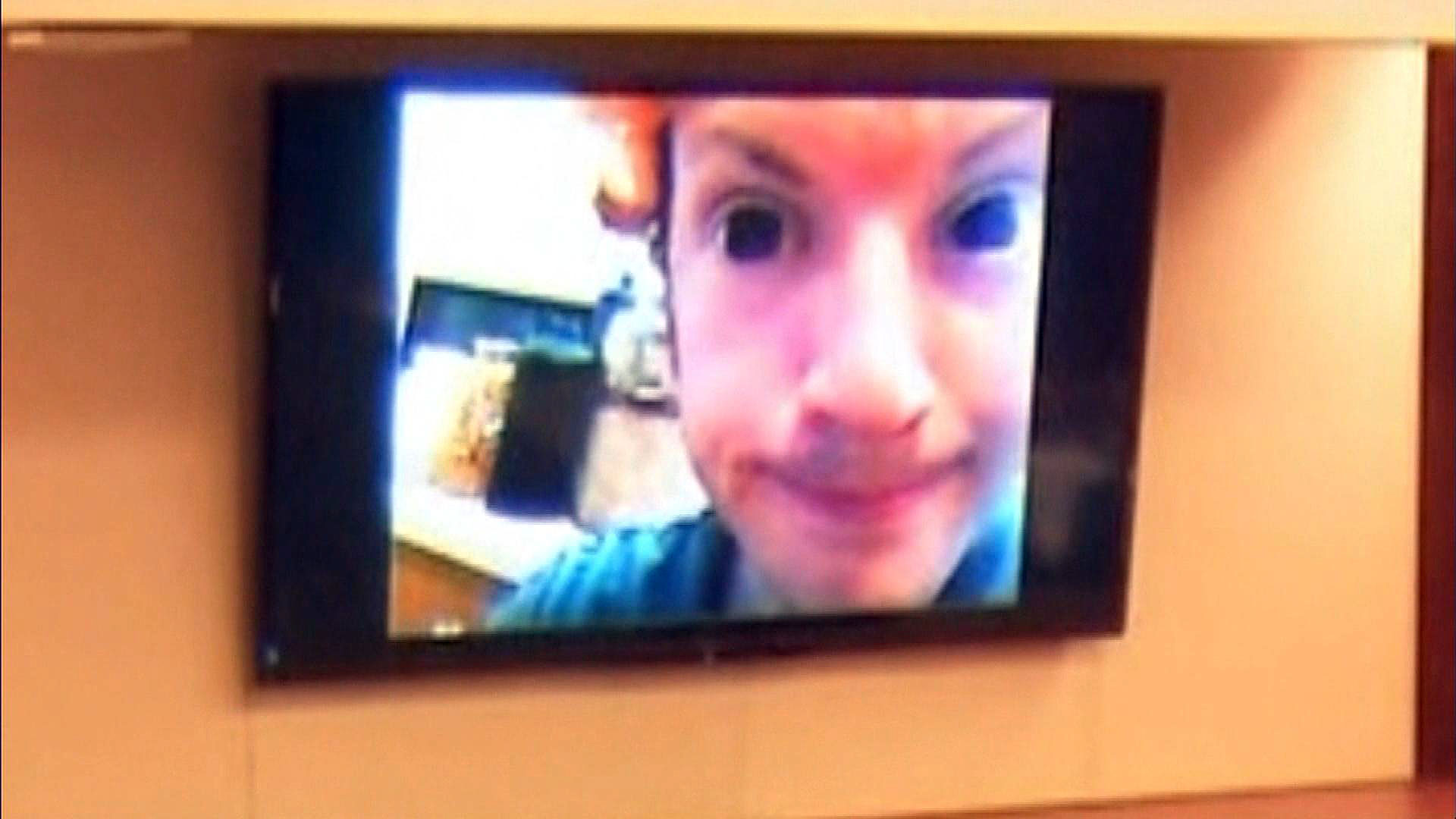 James Holmes in a selfie wearing black contact lenses (credit: CBS)