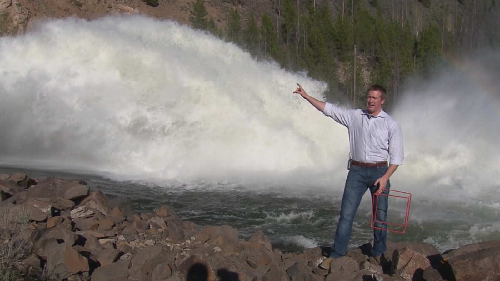 Meteorologist Justin McHeffey in the Mobile Weather Lab shows the runoff from Lake Granby (credit: CBS)