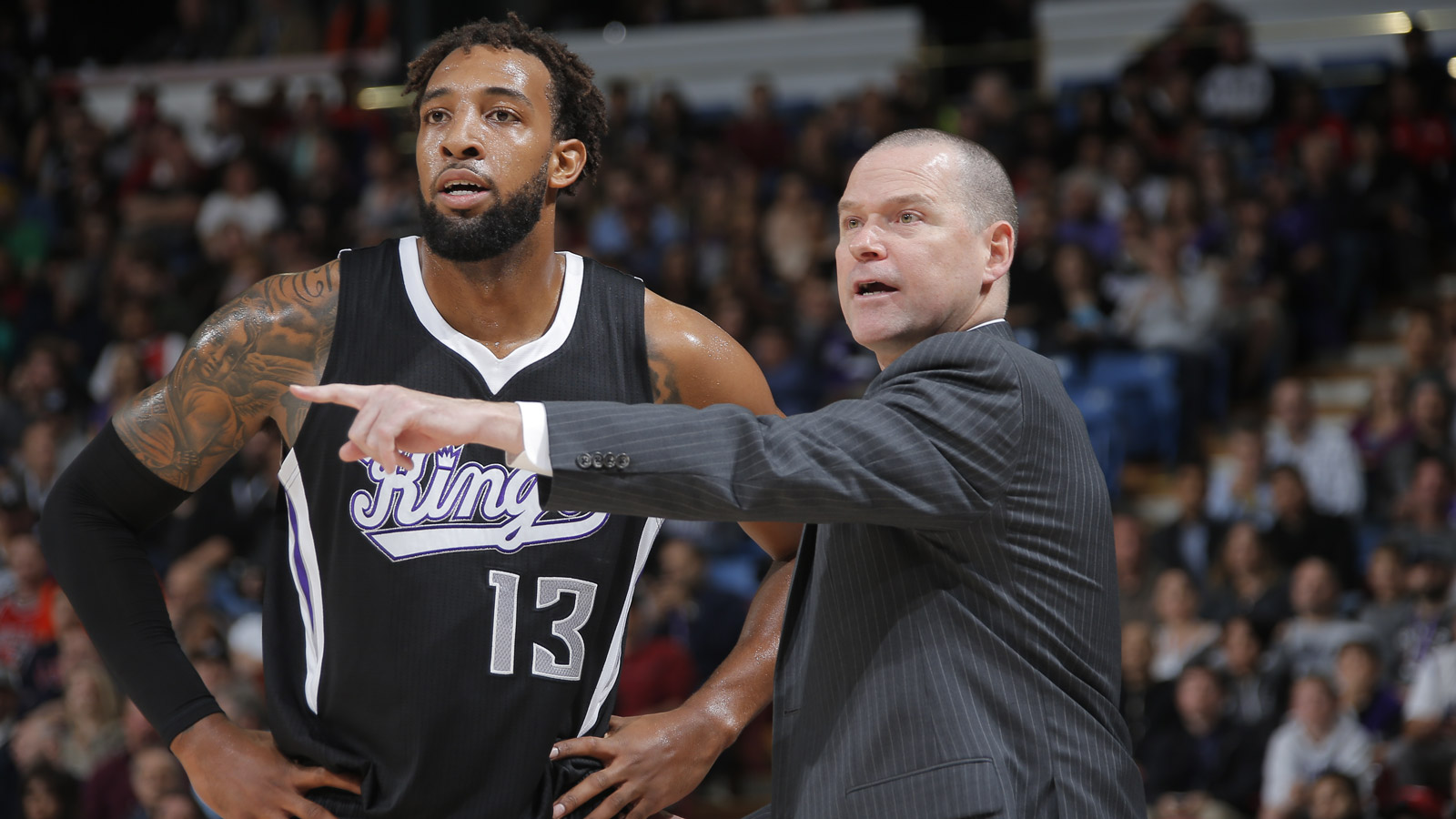 Head coach Michael Malone of the Sacramento Kings with Derrick Williams on Nov. 20, 2014 at Sleep Train Arena in Sacramento. (credit: Rocky Widner/NBAE via Getty Images)