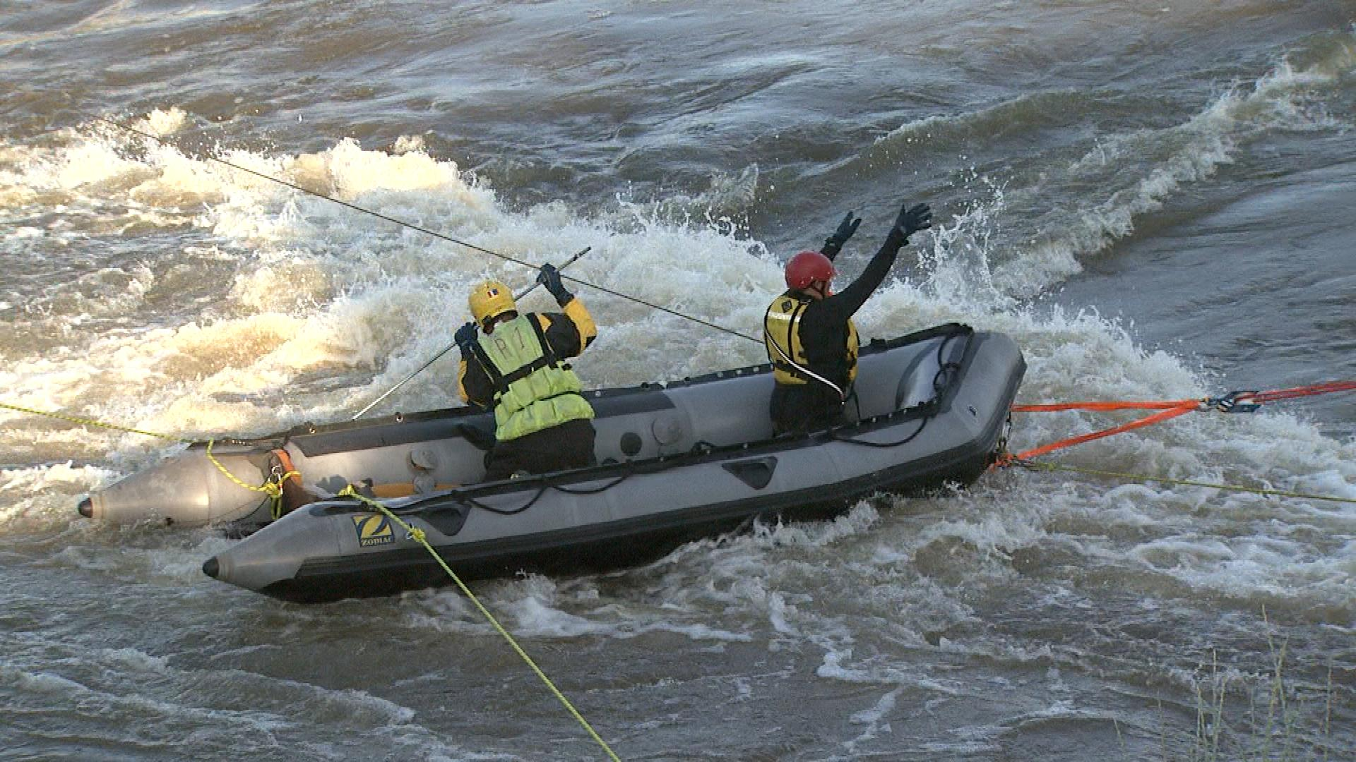 Crews searching the South Platte River (credit: CBS)