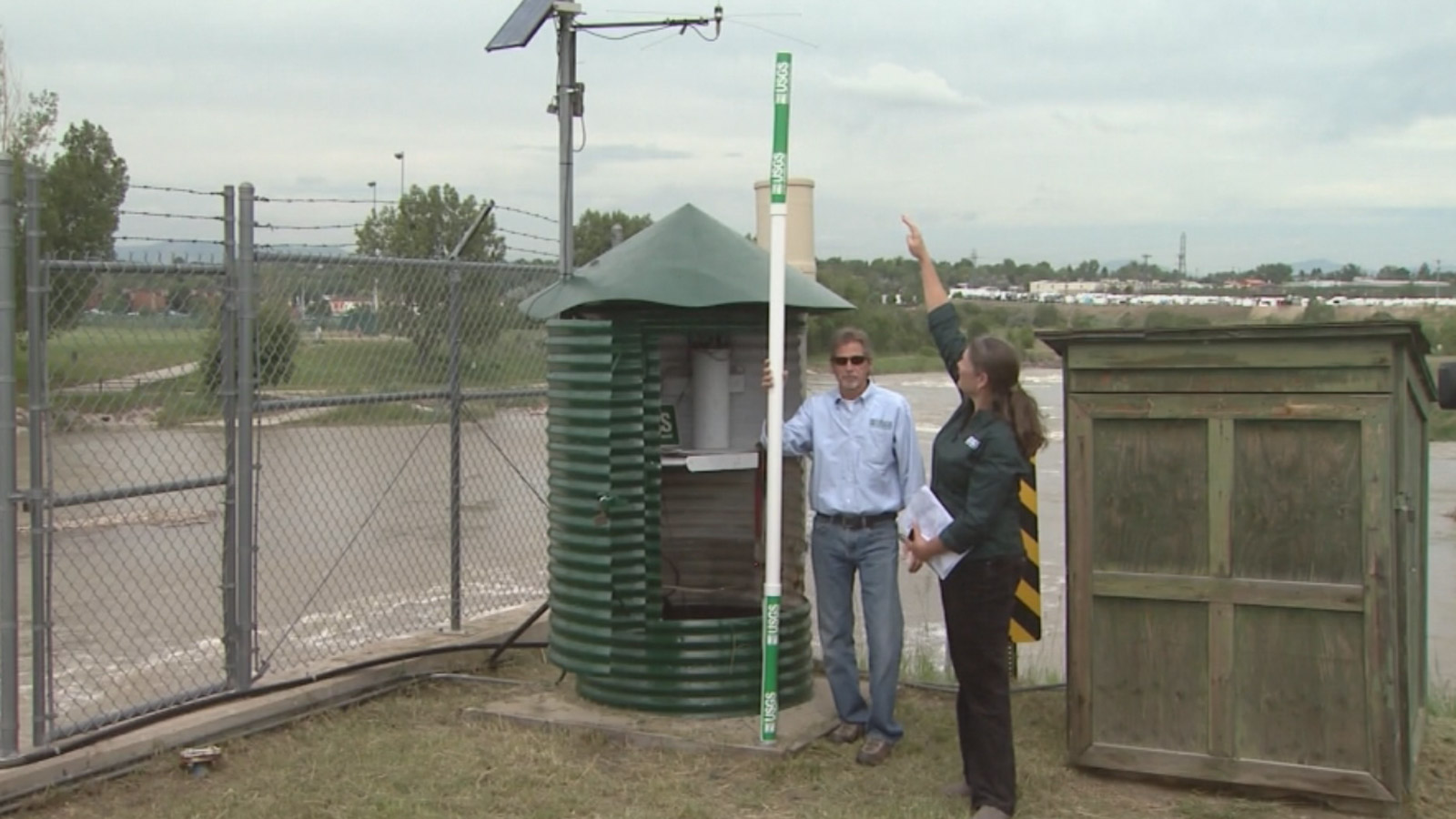 USGS Hydrologist Suzanne Paschke points out the water level during the 1965 South Platte flooding would have reached to top of the pole (credit: CBS)