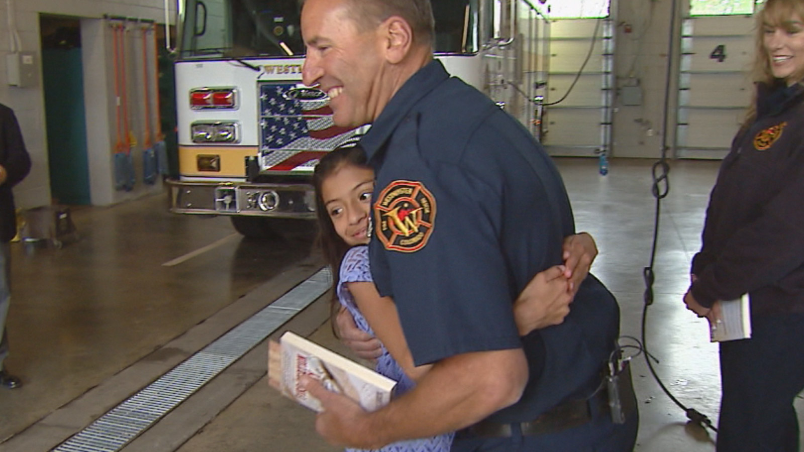 Halle Burke was reunited with the firefighters who took her in 12 years ago (credit: CBS)