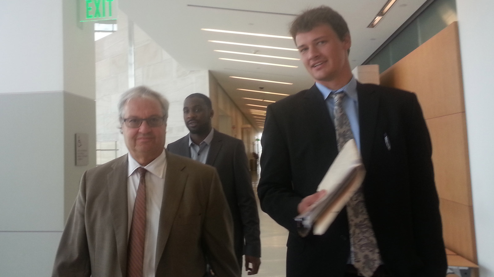 Denver Nuggets Ty Lawson walks behind his lawyer Harvey Steinberg in court on Friday (credit: CBS)