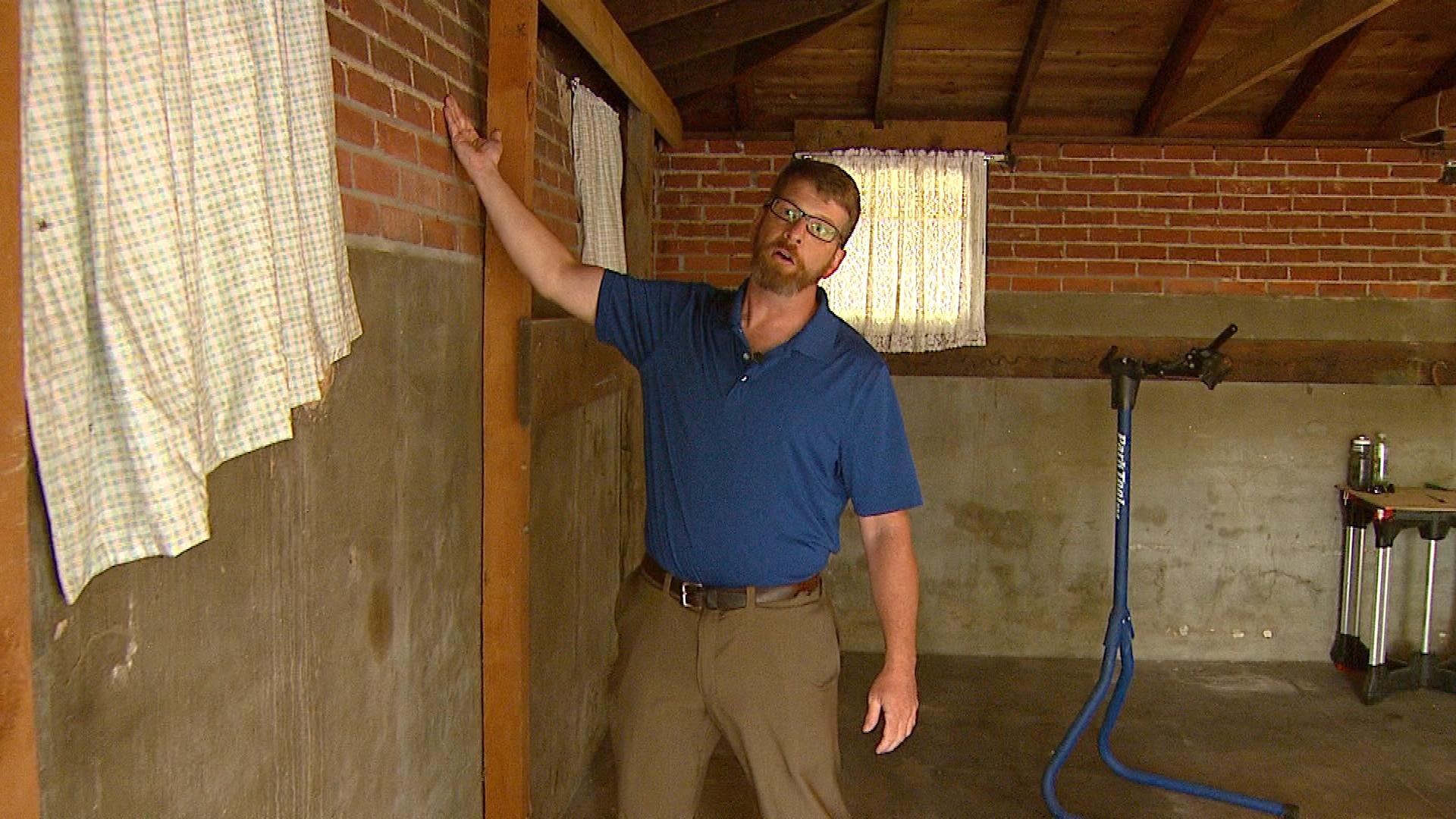 Fred Beck shows off work he needs on his garage (credit: CBS)