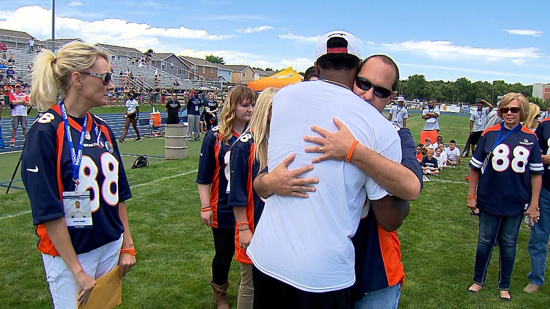 Demaryius Thomas giving a hug to Drake Durkee's father (credit: CBS)