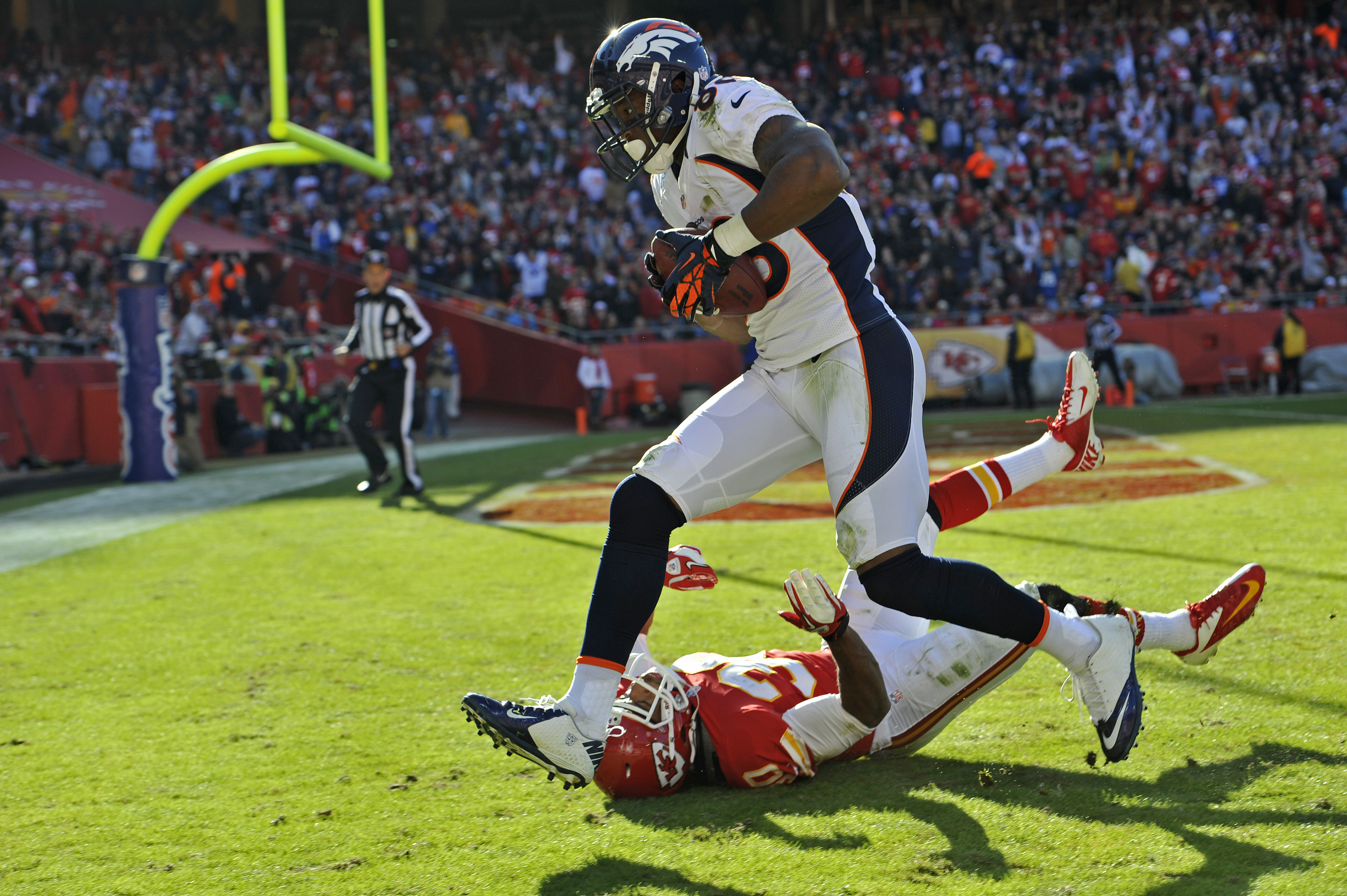 Wide receiver Demaryius Thomas #88 of the Denver Broncos catches a 30-yard touchdown pass against defensive back Jalil Brown #30 of the Kansas City Chiefs during the third quarter on Nov. 25, 2012 at Arrowhead Stadium. (Photo by Peter Aiken/Getty Images)