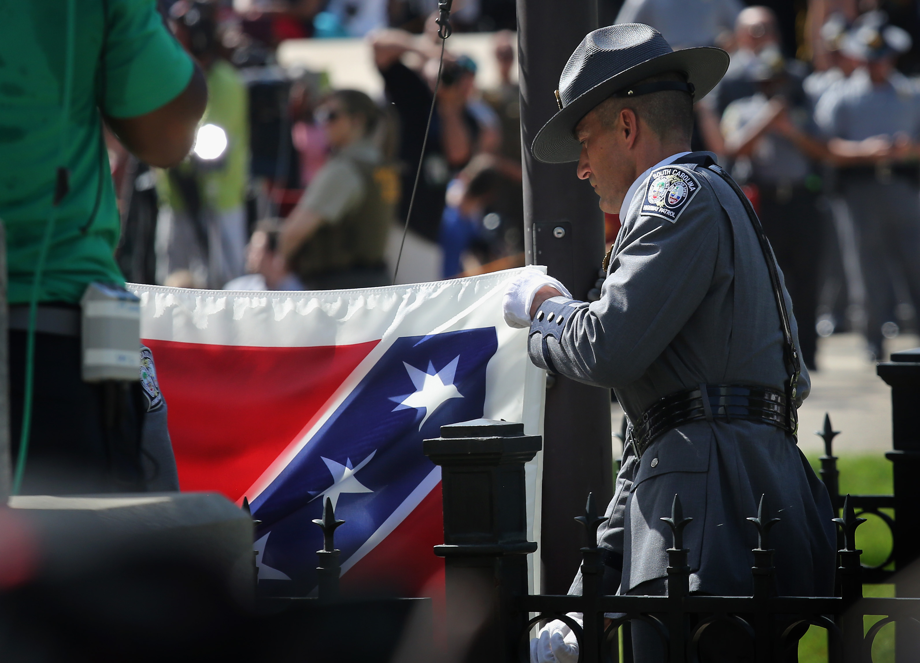A South Carolina honor guard lowers the Confederate flag from the Statehouse grounds on July 10, 2015 in Columbia, South Carolina. Republican Governor Nikki Haley presided over the event after signing the historic legislation to remove the flag the day before.  (Photo by John Moore/Getty Images)