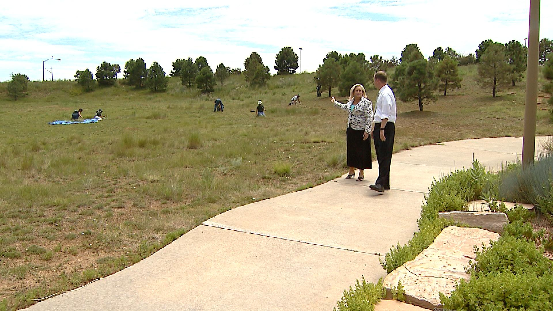 Kim Stuart with the City of Aurora shows CBS4's Jeff Todd the location picked for the permanent memorial (credit: CBS)