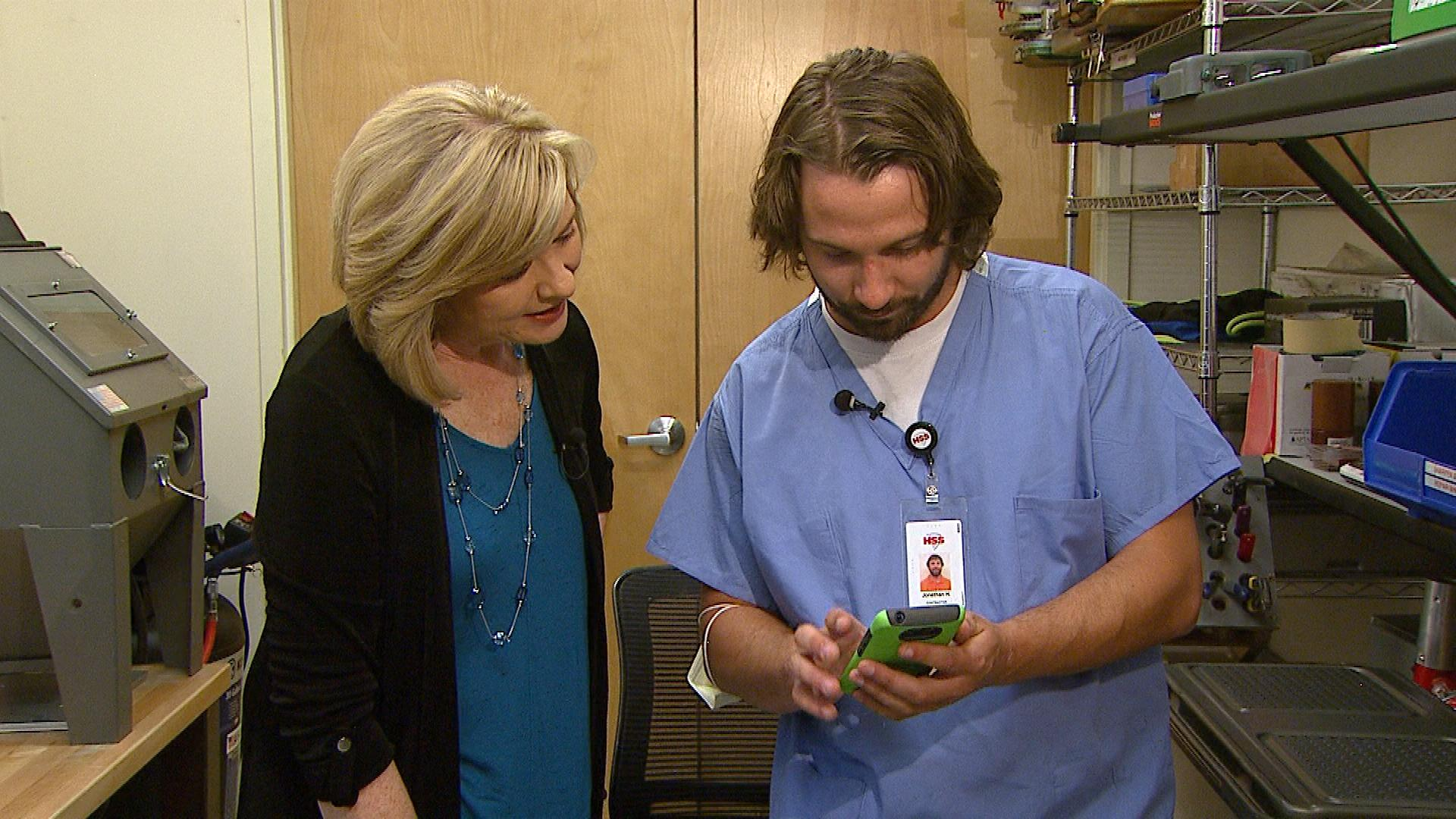 Johnathon Hardman shows CBS4's Kathy Walsh a picture of his new dog Blitz (credit: CBS)