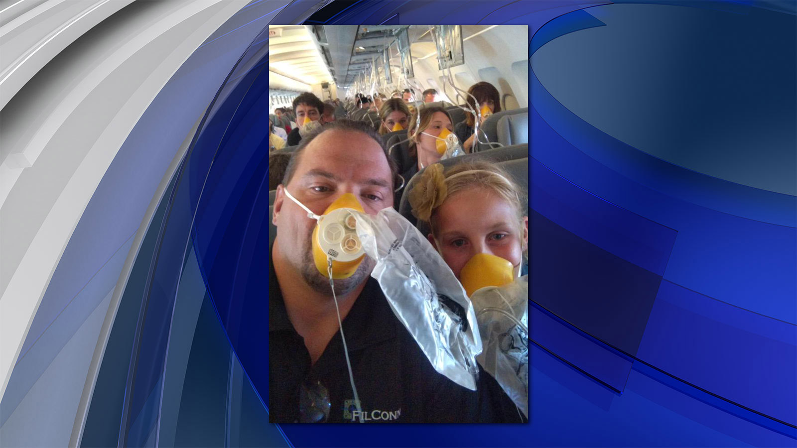 Jason and Victoria Pedruzzi on board the United Airlines flight that made an emergency landing (credit: Jason Pedruzzi)