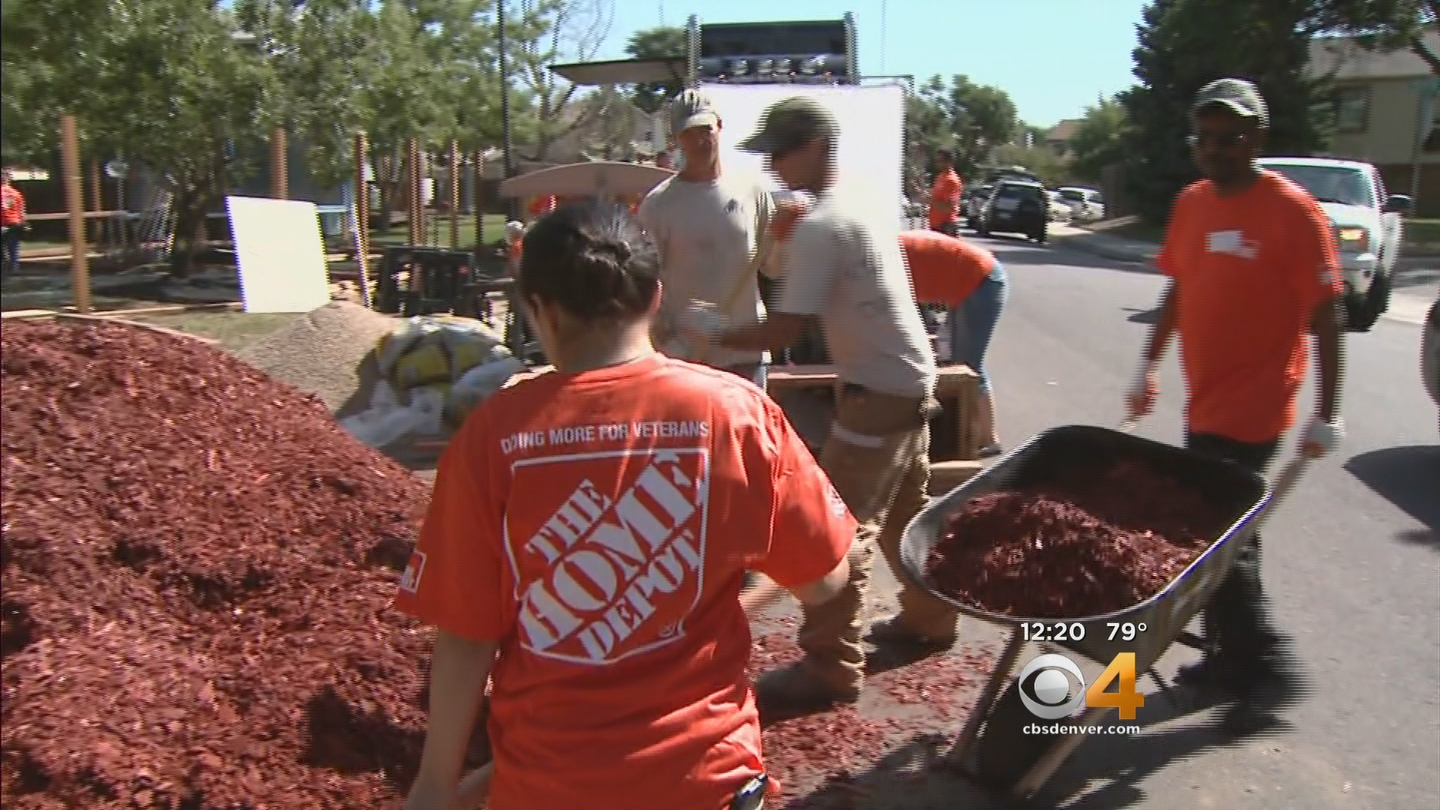Home Depot volunteers helped Dyanna Aragon reclaim her yard on Tuesday (credit: CBS)