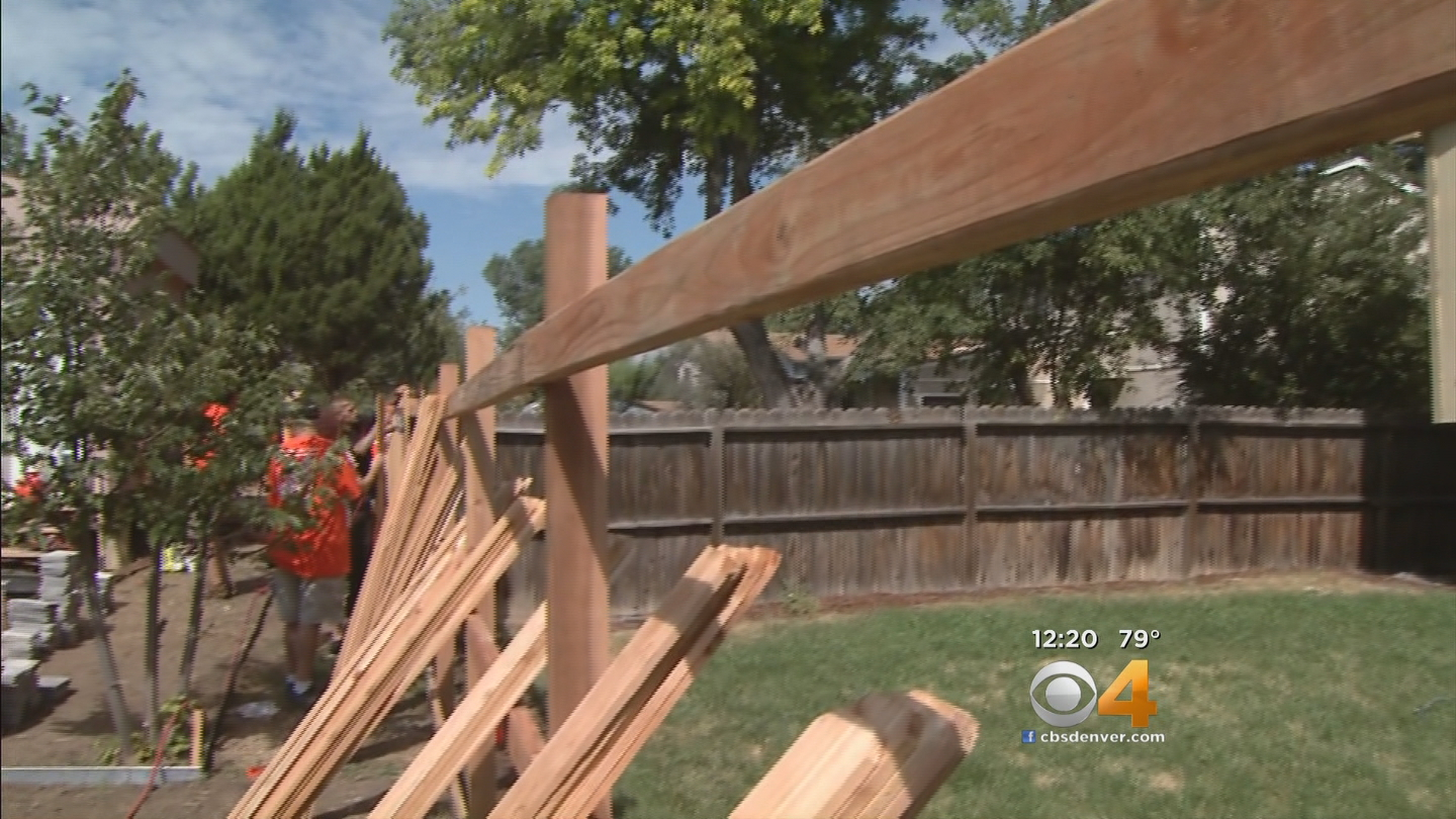 A new fence is just one project Home Depot volunteers completed on Tuesday (credit: CBS)
