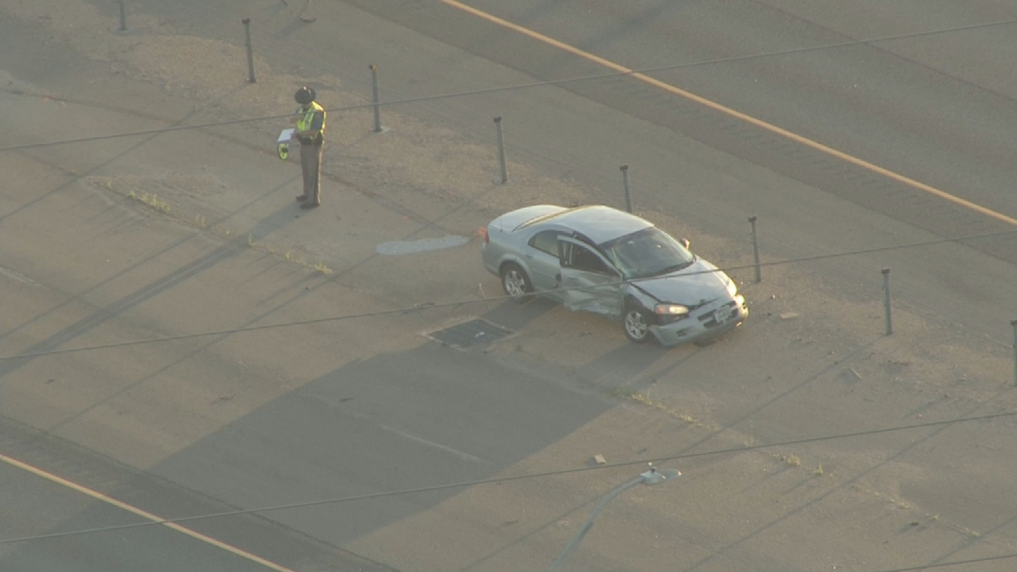 Copter4 flew over the Dodge Stratus involved in a deadly motorcycle crash on I-25 near the Mead exit (credit: CBS)