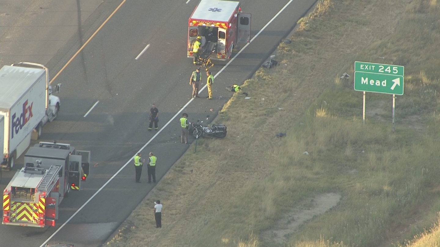 Copter4 flew over investigators at the scene of a deadly motorcycle crash on I-25 near the Mead exit (credit: CBS)