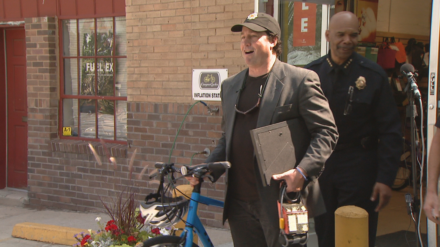 Aaron Miripol receives a new bicycle from Denver Police as a thank you for helping capture a suspect (credit: CBS)